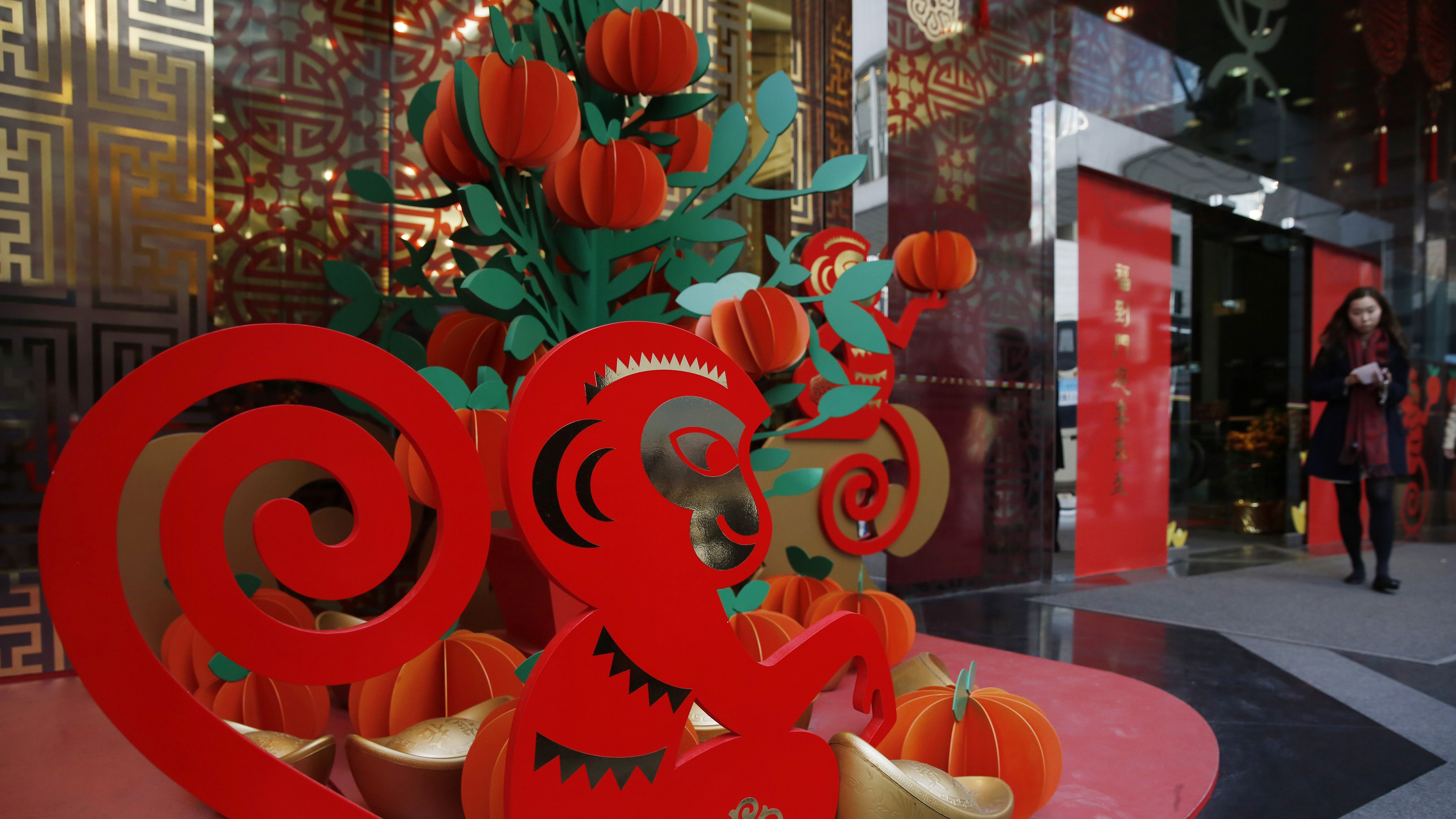 Chinese New Year decorations are placed outside a bank in Hong Kong, Thursday, Feb. 4, 2016. Chinese will celebrate the Lunar New Year on Feb. 8 this year, marking the start of the Year of Monkey on the Chinese zodiac.
