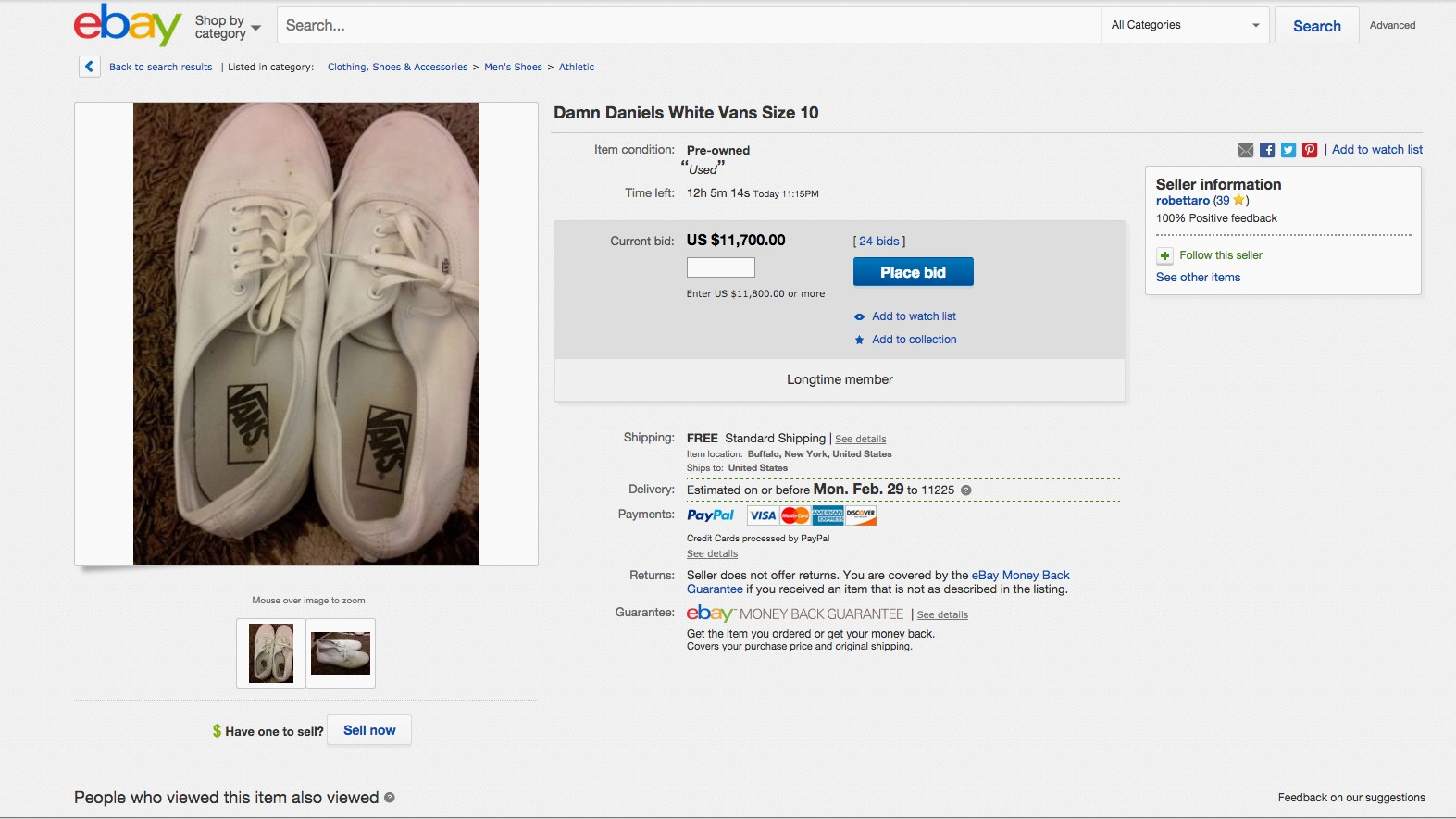 "An eBay listing for ""damn daniels white vans"""