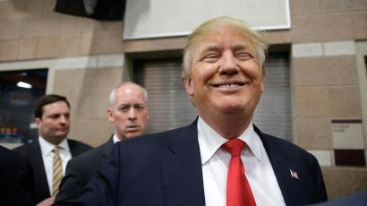 Republican presidential candidate Donald Trump smiles as he greets voters at a caucus site Tuesday, Feb. 23, 2016, in Las Vegas. (AP Photo/Jae C. Hong)