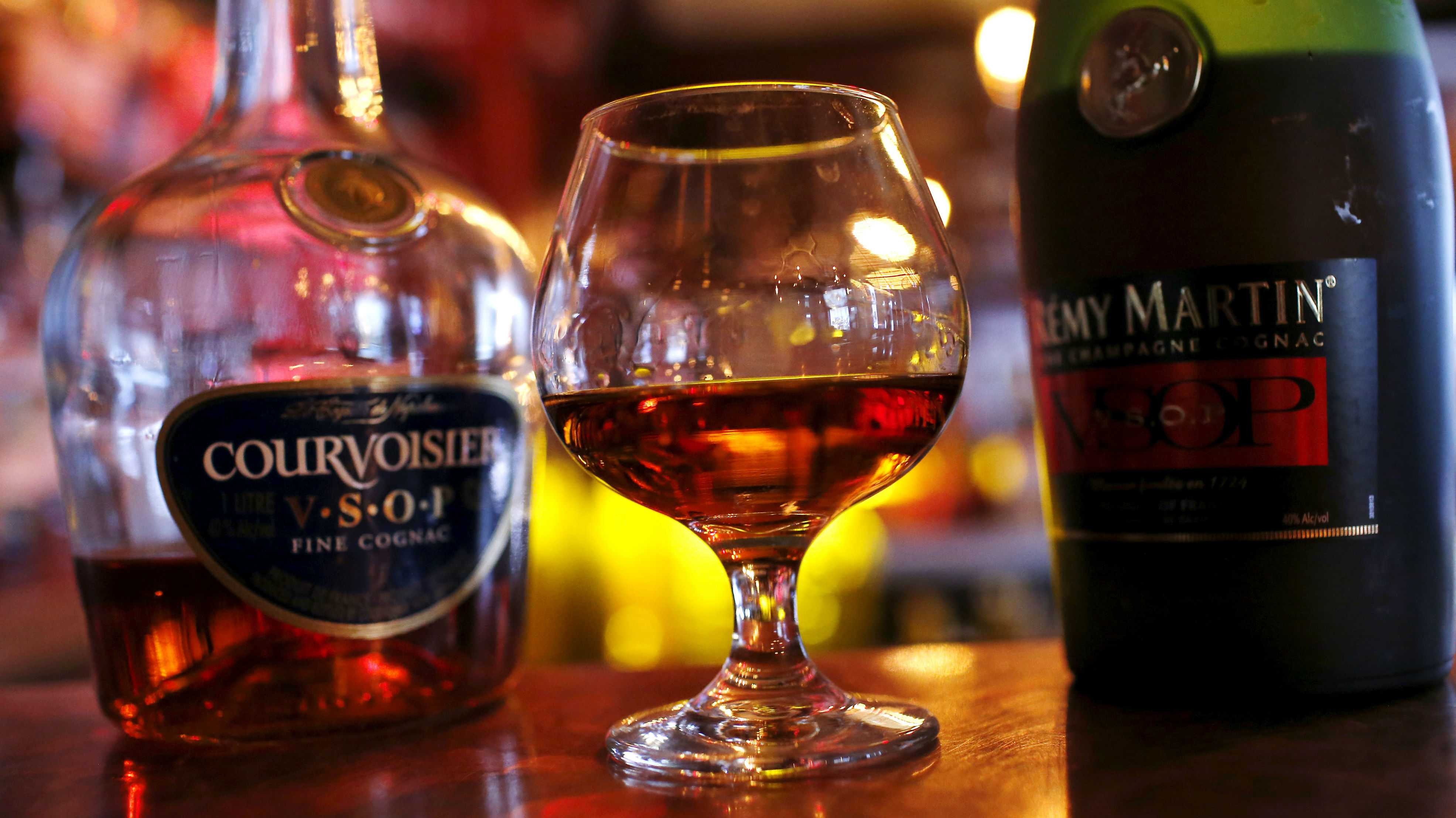 A glass of cognac is pictured on a bar in the Manhattan borough of New York City, November 13, 2015. France's centuries-old cognac houses are raising their bets on the U.S. market with new products and campaigns to broaden the drink's appeal beyond its African American stronghold. The big four producers -- LVMH Moet Hennessy, Remy Cointreau, Pernod Ricard and Beam Suntory -- have turned more of their attention to the U.S. following a drop in sales in China after an anti-graft campaign. To match story USA-COGNAC Picture taken November 13, 2015.