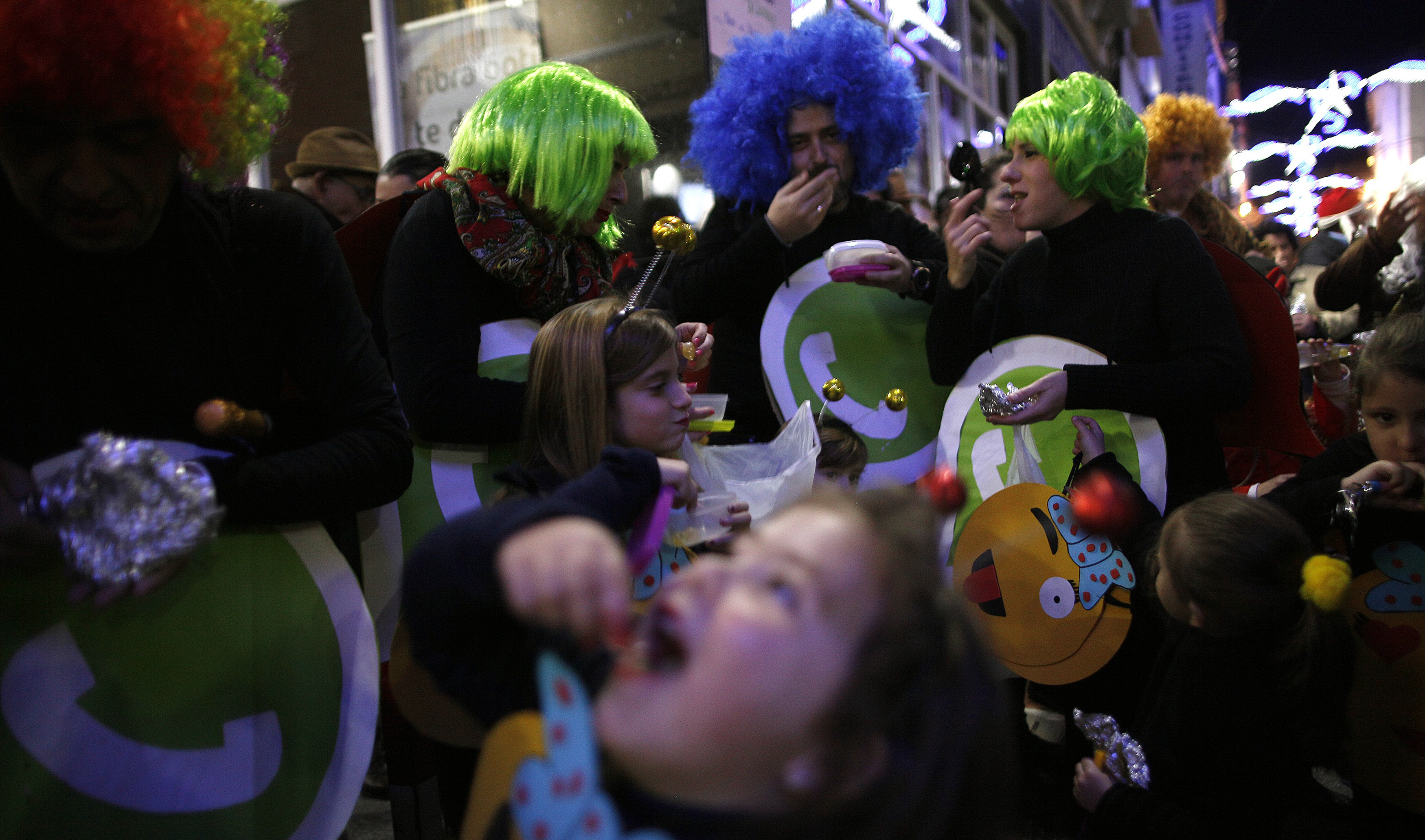 Revellers dressed up as a Whatsapp logo take part in the Spanish tradition of eating 12 grapes at midnight, as they take part in New Year's celebrations in Coin, near Malaga, southern Spain, early January 1, 2015. Villagers and revellers dressed up in funny costumes to take part in the New Year's celebration. REUTERS/Jon Nazca (SPAIN - Tags: SOCIETY ANNIVERSARY) - RTR4JT04