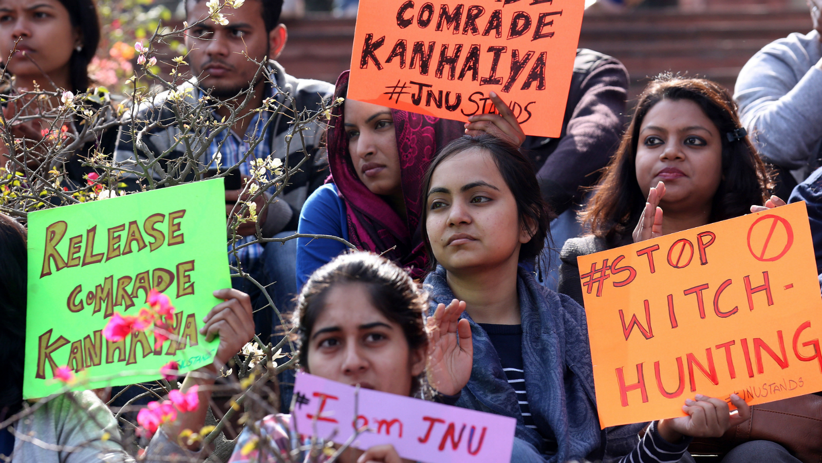 Indian students of the Jawaharlal Nehru University (JNU) hold placards during a protest inside JNU campus in New Delhi, India, 16 February 2016. A former Delhi University professor was arrested on 16 February for sedition, as protests escalated at another university whose students' union president was earlier detained for the same charge. Activists from the ruling Hindu nationalist Bharatiya Janata Party's student wing and right-wing organizations, which accuse demonstrators of being 'anti-nationals', also gathered near the university for counter-protests.