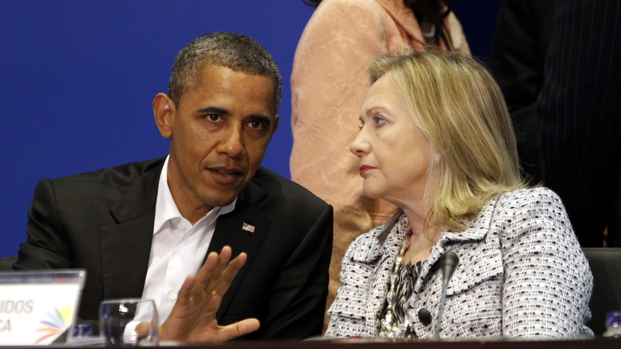U.S. President Barack Obama and Secretary of State Hillary Clinton talk during the plenary session of the Summit of the Americas in Cartagena April 14, 2012. Obama tried on Saturday to convince skeptical Latin Americans that Washington has not turned its back on them, but ruled out a drug policy U-turn that some in the region want.