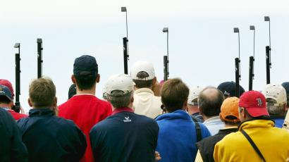 Spectators use periscopes to catch the action at the 35th Ryder Cup matches at Oakland Hills Country Club in Bloomfield Township, Mich., on Friday, Sept. 17, 2004. (AP Photo/Paul Sancya)
