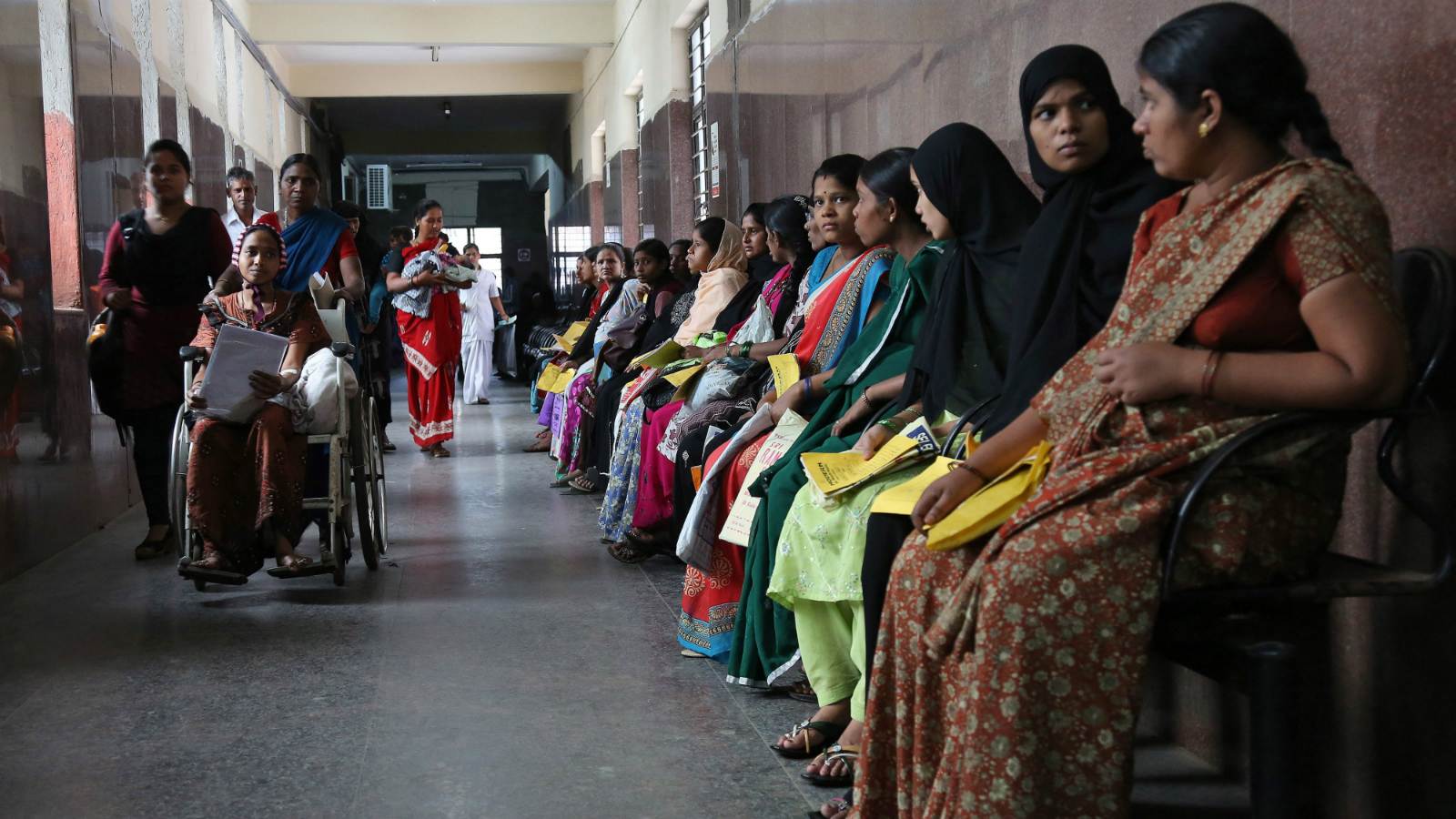 Pregnant Indian women hold their medical cards and wait for their turn to be examined at a government hospital on World Population Day in Hyderabad, India, Friday, July 11, 2014. India is the second most populous country with 1.2 billion people next to China, with its capital being the second most populated city in the world. (AP Photo/Mahesh Kumar A.)