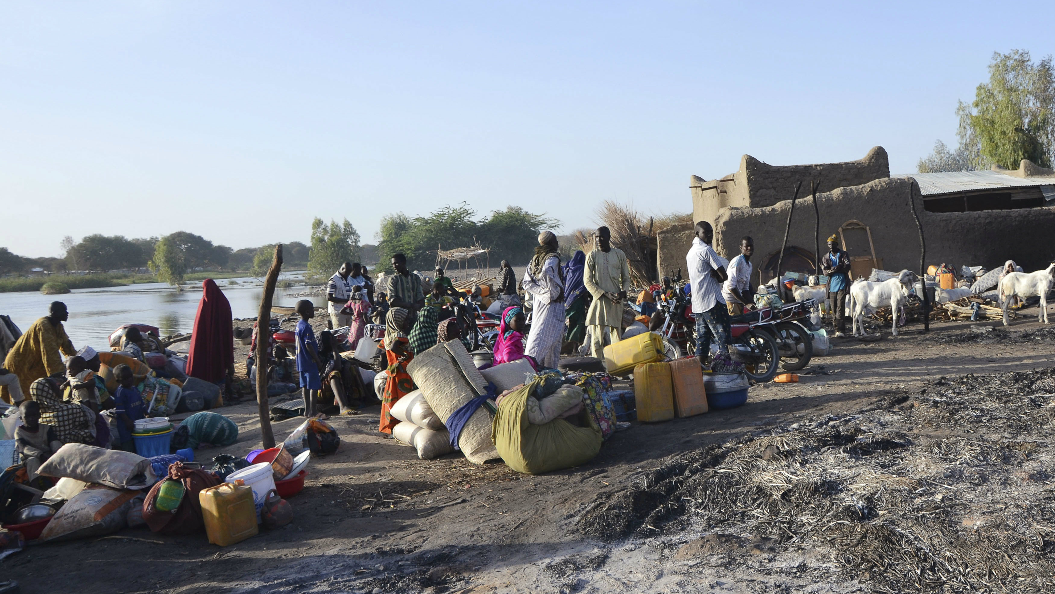 People prepare to flee the village of Ngouboua hours after an attack by Boko Haram militants, February 13, 2015.