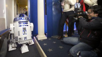 R2D2 greets members of the press during a surprise visit to the Brady Press Briefing Room of the White House, Friday, Dec. 18, 2015. The Star Wars movie characters will greet children of Gold Star families who are attending a special screening of Star Wars The Force Awakens later today at the White House Family Theater. (AP Photo/Pablo Martinez Monsivais)