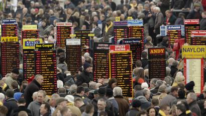 Bookmakers boards are seen at the Cheltenham Festival horse racing meet in Gloucestershire, western England March 16, 2012.