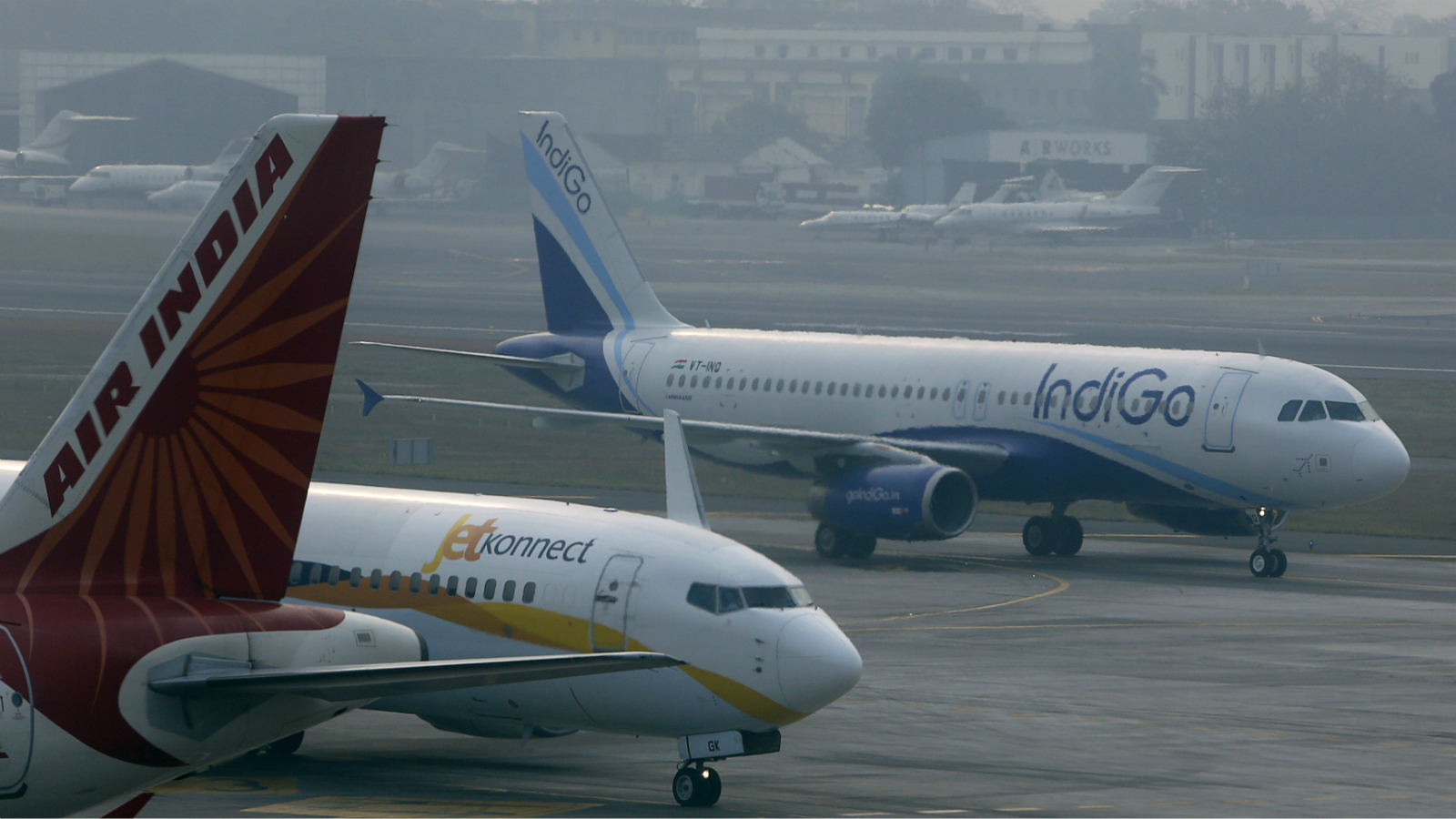 An IndiGo Airlines Airbus A320 aircraft and JetKonnect Boeing 737 aircraft taxi past an Air India Airbus A321 aircraft at Mumbai's Chhatrapathi Shivaji International Airport February 3, 2013. Picture taken February 3, 2013.