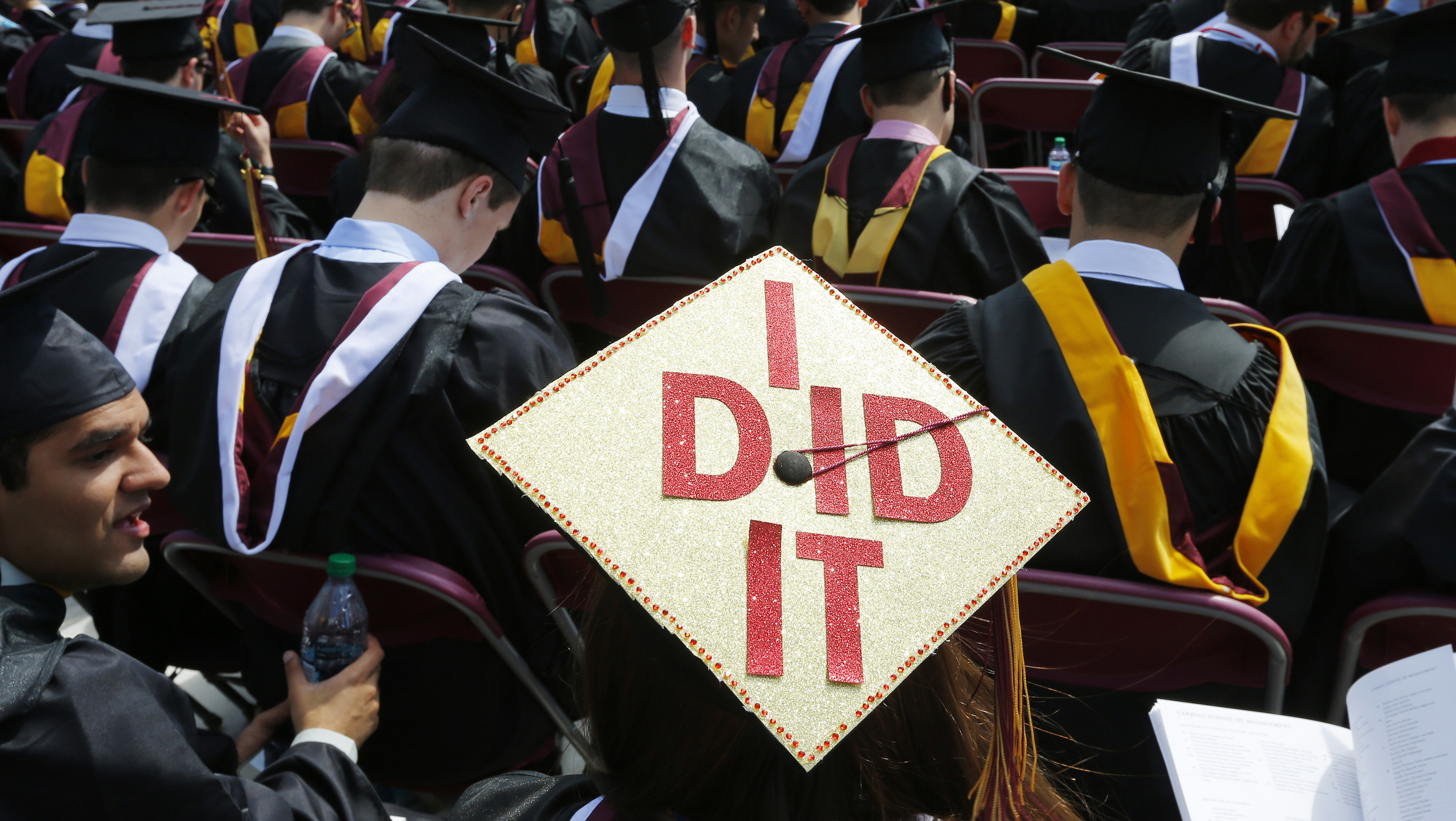 "Graduating student Katherine Thomas has ""I Did It"" written on her mortar board during Commencement Exercises at Boston College in  Boston, Massachusetts May 19, 2014.    REUTERS/Brian Snyder (UNITED STATES - Tags: EDUCATION SOCIETY) - RTR3PVDK"