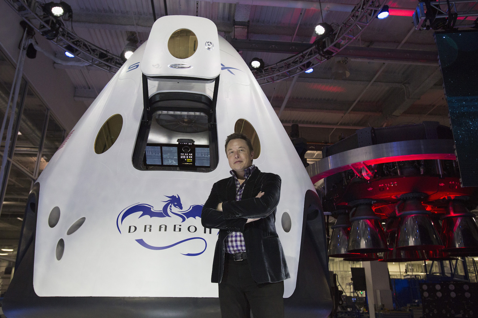 SpaceX CEO Musk poses by the Dragon V2 spacecraft after it was unveiled in Hawthorne