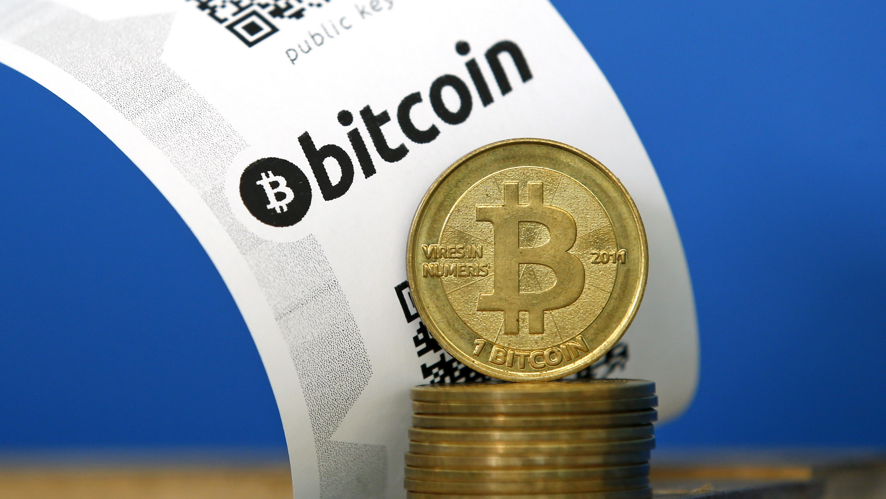A Bitcoin (virtual currency) paper wallet with QR codes and coins are seen in an illustration picture taken at La Maison du Bitcoin in Paris July 11, 2014. French police dismantled an illegal Bitcoin exchange and seized 388 virtual currency units worth some 200,000 euros ($272,800) in the first such operation in Europe a public prosecutor said on Monday.   REUTERS/Benoit Tessier (FRANCE - Tags: BUSINESS) - RTR3Y7LN