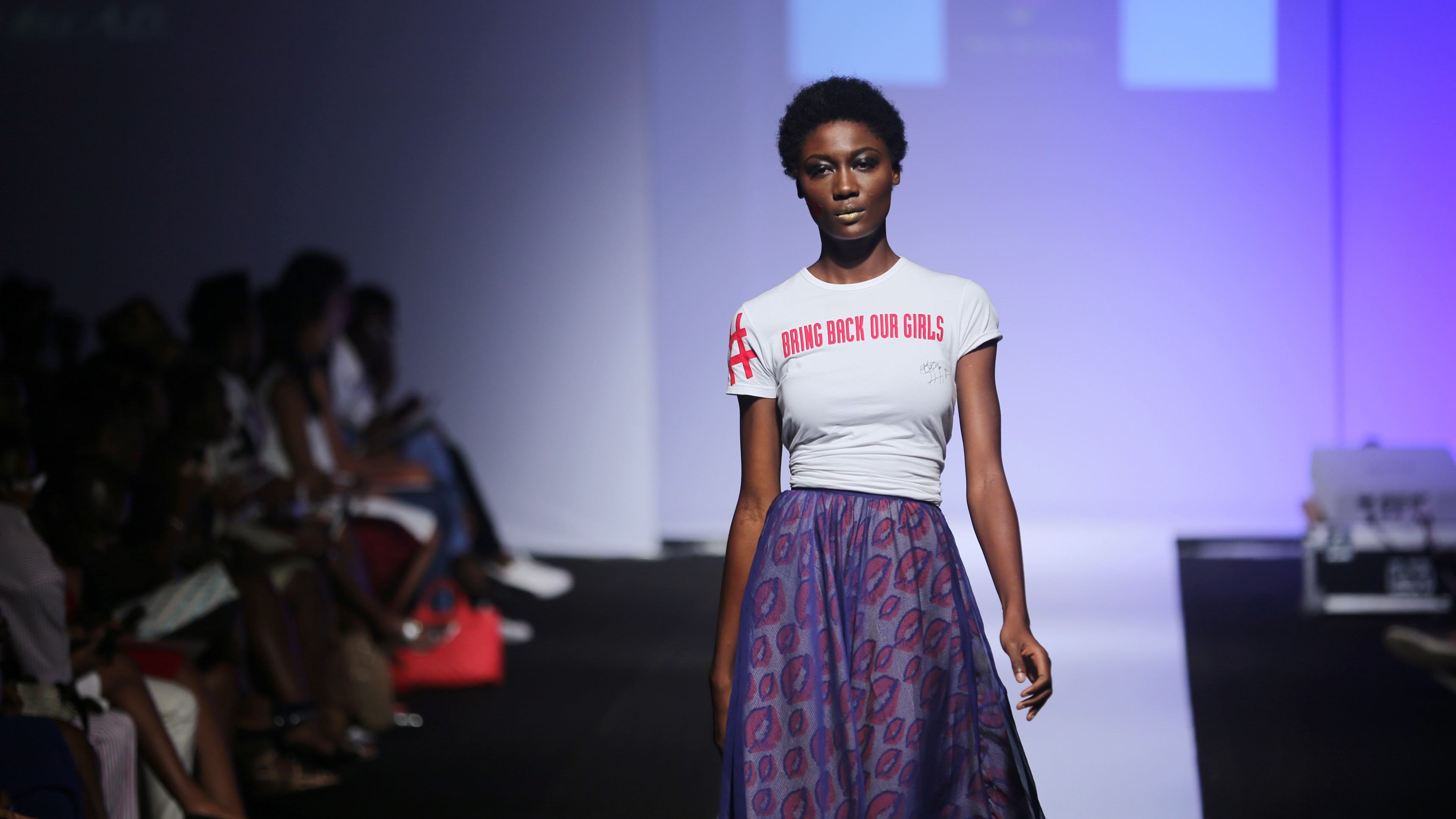 A model presents a creation by Kiki Kamanu during Lagos Fashion and Design Week in Lagos October 31, 2014. Picture taken October 31, 2014. REUTERS/Akintunde Akinleye (NIGERIA - Tags: FASHION) - RTR4CEN6