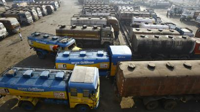 Oil tankers are seen parked at a yard outside a fuel depot on the outskirts of Kolkata.