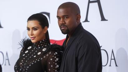 Television personality Kim Kardashian arrives with Kanye West to attend the 2015 CFDA Fashion Awards in New York June 1, 2015.