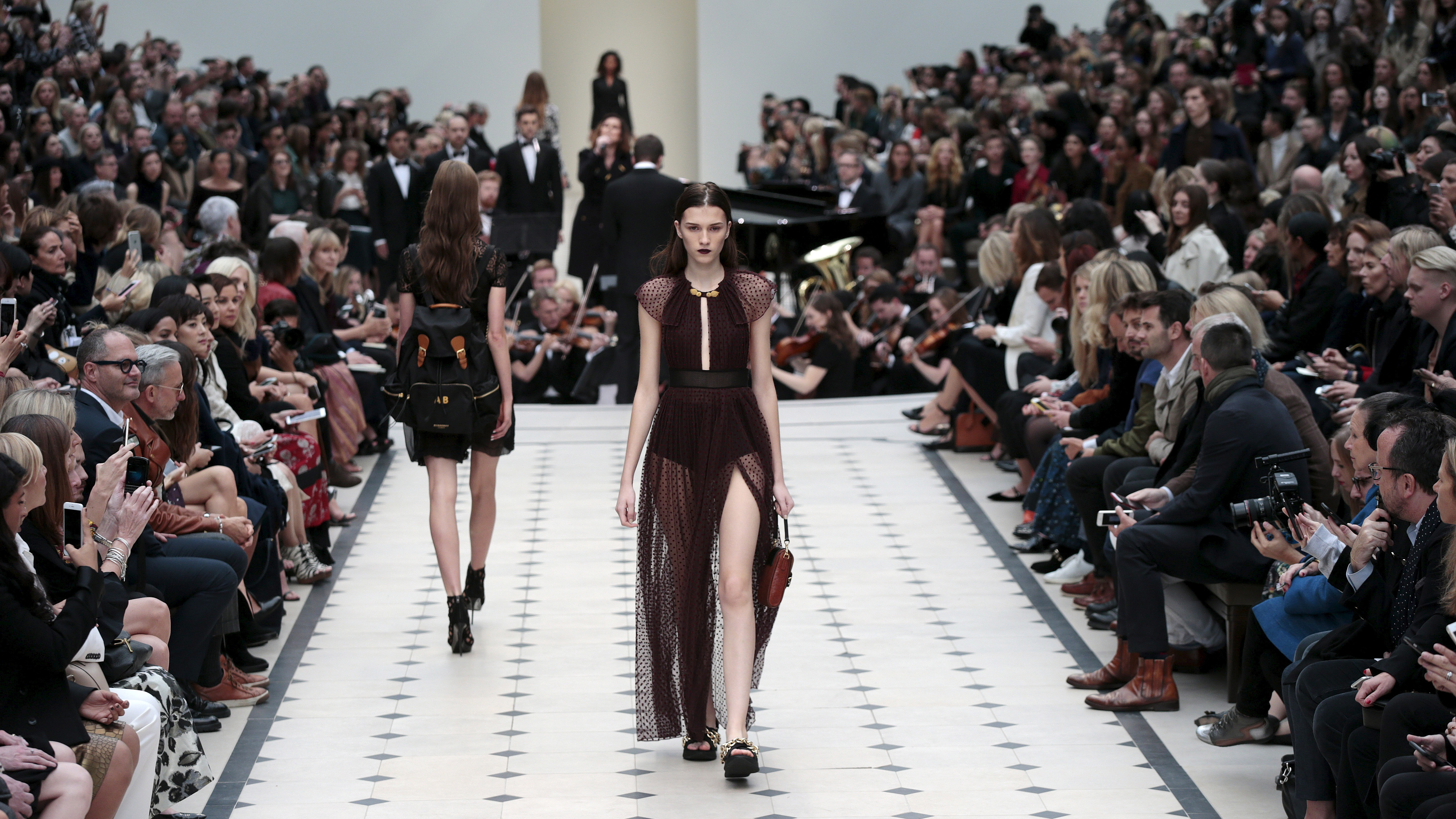Models present creations from the Burberry Prorsum Spring/Summer 2016 collection during London Fashion Week September 21, 2015.