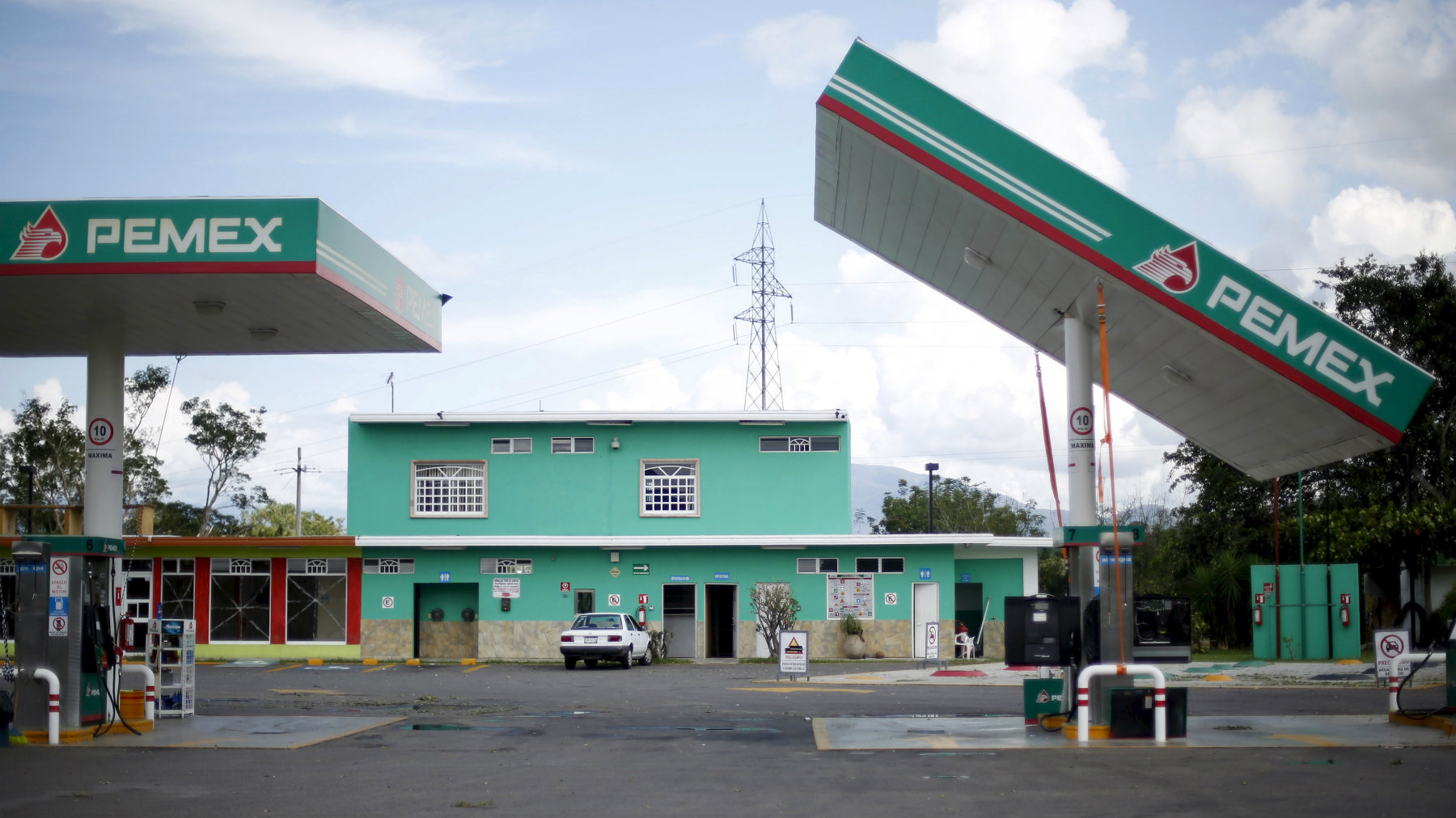 The damaged roof of a Pemex gas station is seen in Casimiro, Mexico October 24, 2015. Hurricane Patricia caused less damage than feared on Mexico's Pacific coast on Saturday, but little was known about an isolated part of the shoreline dotted with luxury villas and fishing villages, where the storm and its 165 mph (266 kph) winds landed.Thousands of residents and tourists had fled the advance of the storm, one of the strongest in recorded history, seeking refuge in hastily arranged shelters. There were no early reports of deaths and it appeared major damage was averted as Patricia missed tourist centers like Puerto Vallarta and the major cargo port of Manzanillo. REUTERS/Edgard Garrido