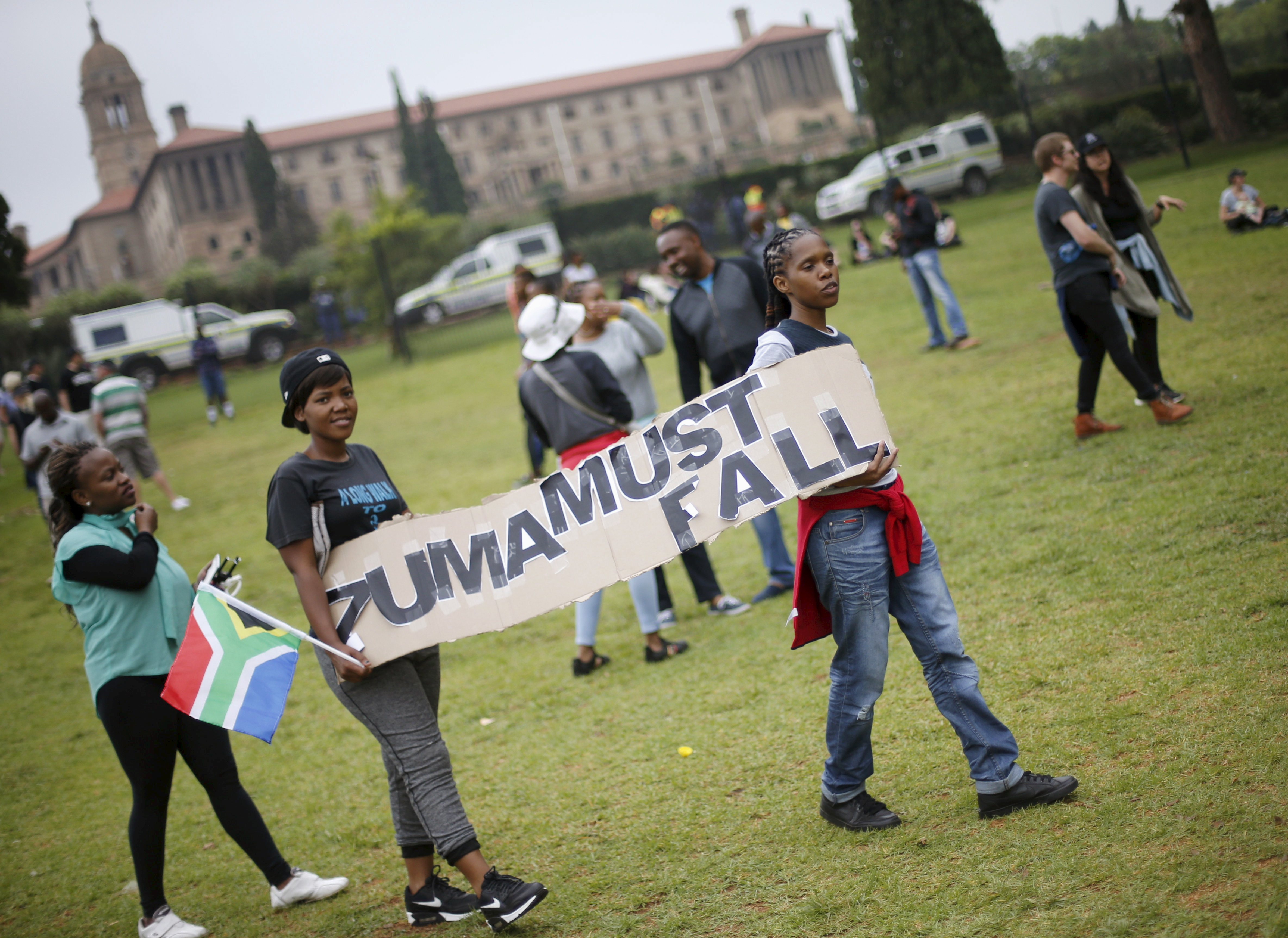 Protesters carry placards as they take part in a 'Zuma must fall' demonstration in Pretoria, South Africa December 16, 2015. REUTERS/Siphiwe Sibeko - RTX1YWWH