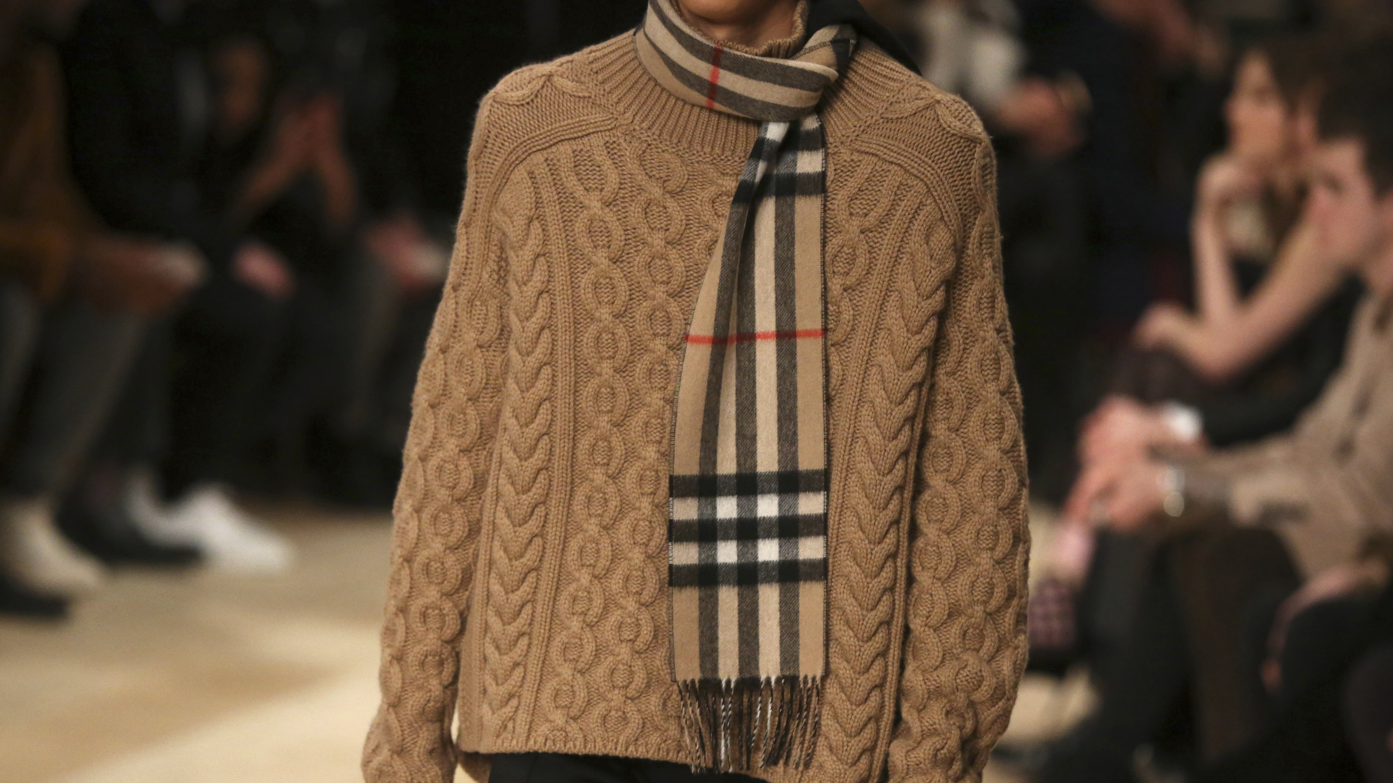 """A model presents a creation from the Burberry catwalk show at the """"London Collections: Men"""" Autumn/Winter 16 in London, Britain January 11, 2016."""