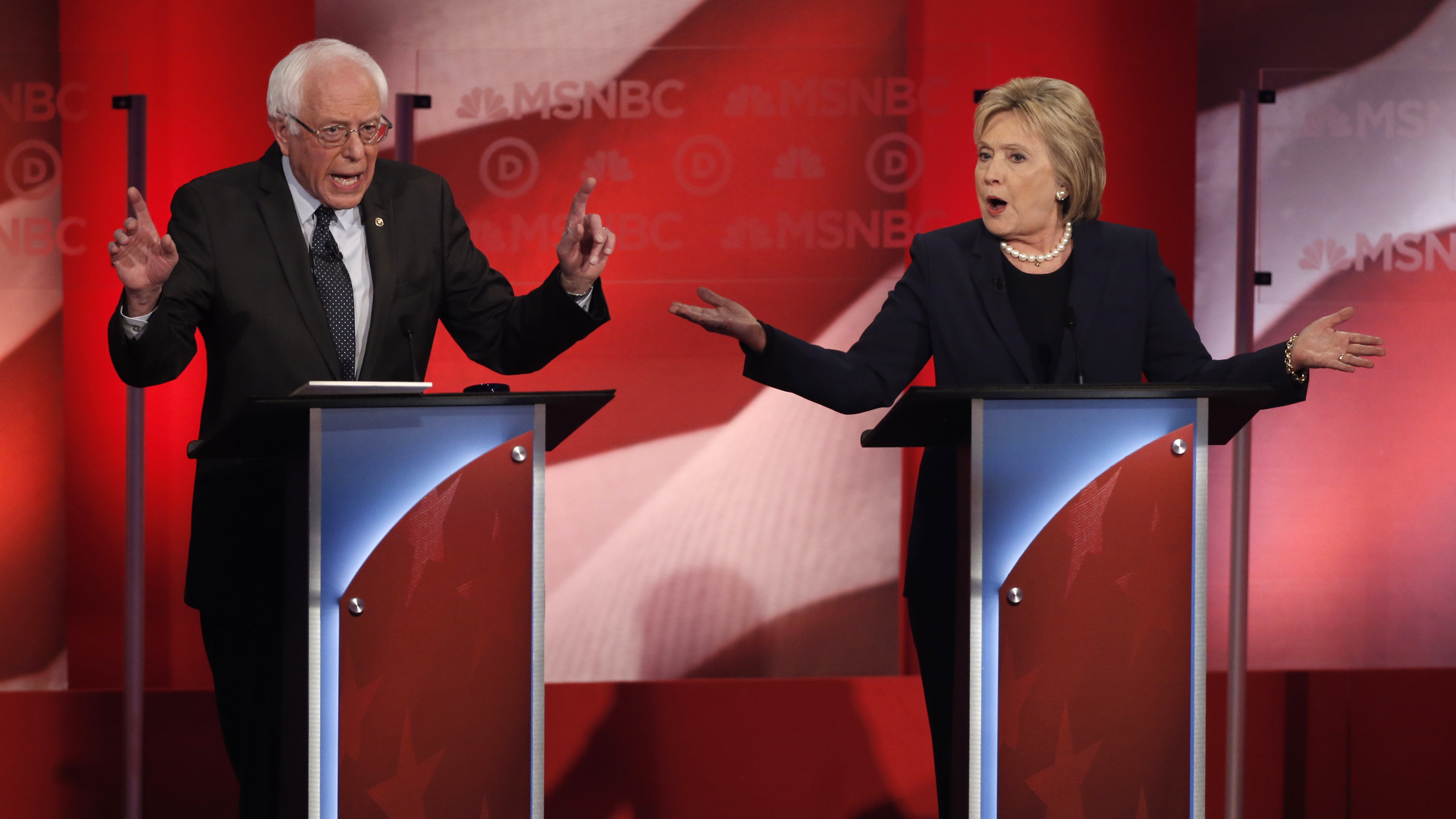 Democratic U.S. presidential candidate Senator Sanders and former Secretary of State Clinton speak as they discuss issues during the Democratic presidential candidates debate sponsored by MSNBC at the University of New Hampshire in Durham