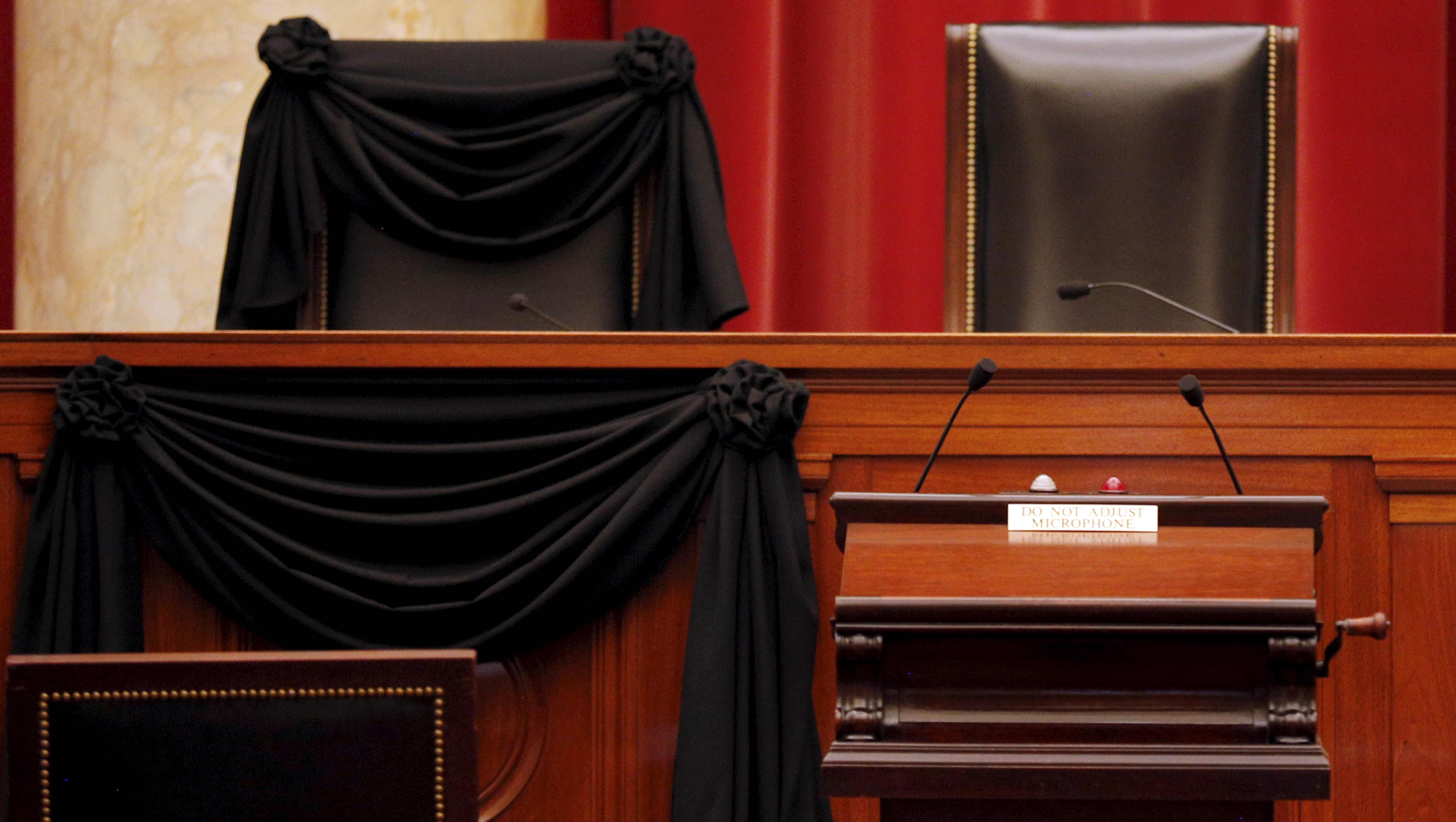 The bench of late Supreme Court Justice Scalia is seen draped with black wool crepe in memoriam inside the Supreme Court in Washington