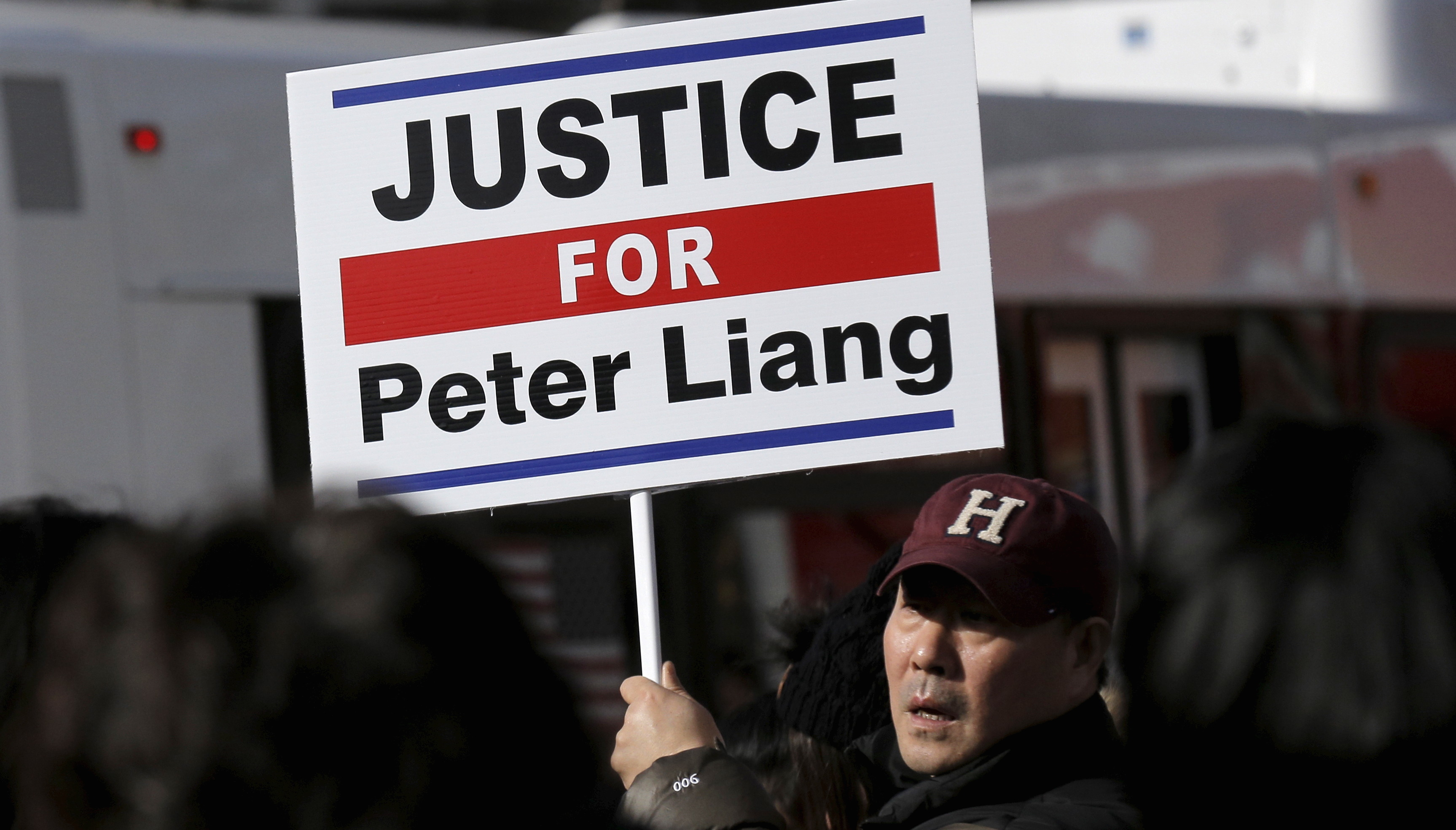 Protesters hold a rally in support of former NYPD officer Peter Liang in Brooklyn