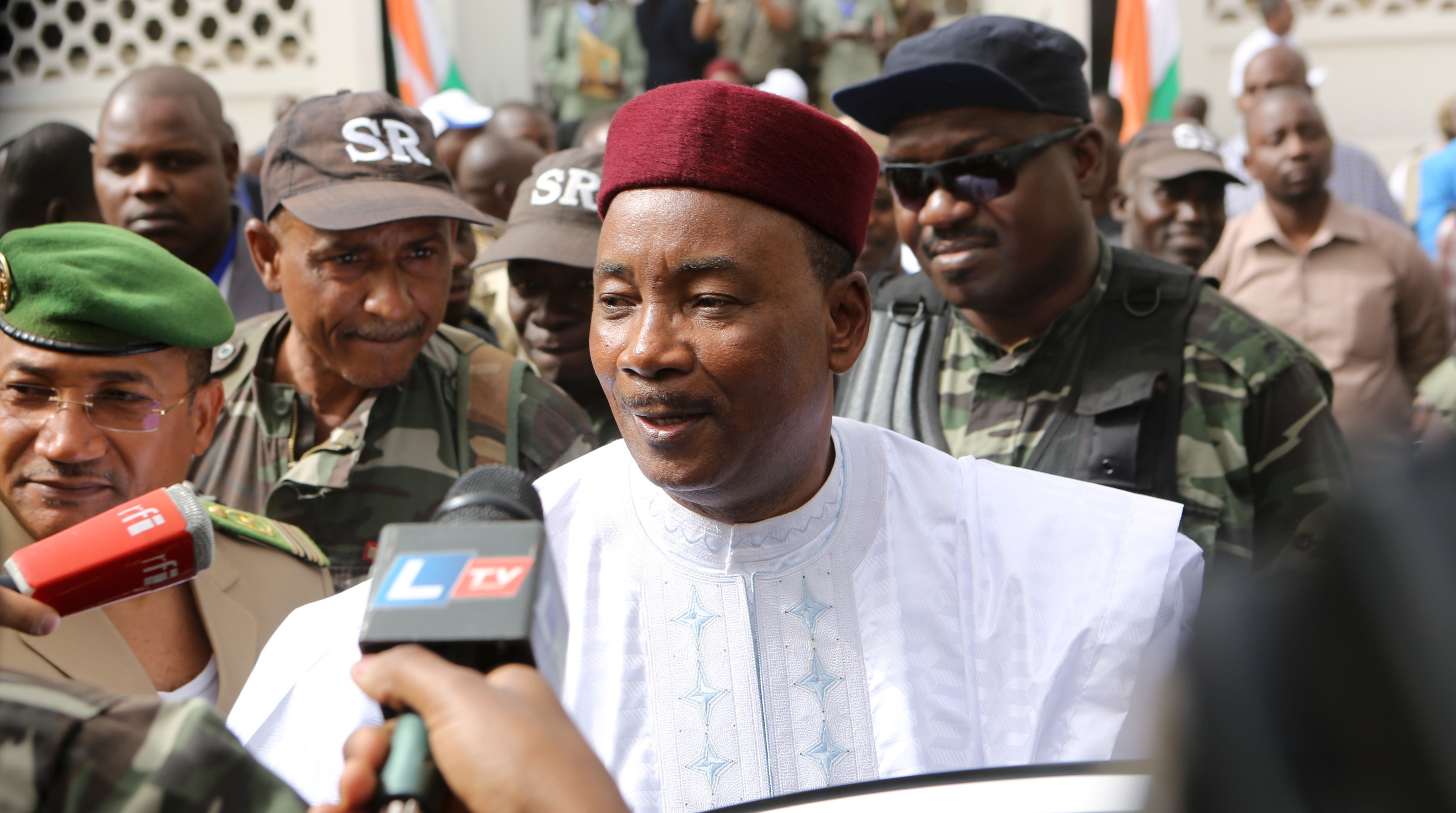 Niger's incumbent President Mahamadou Issoufou speaks to journalists after voting during the country's presidential and legislative elections in Niamey