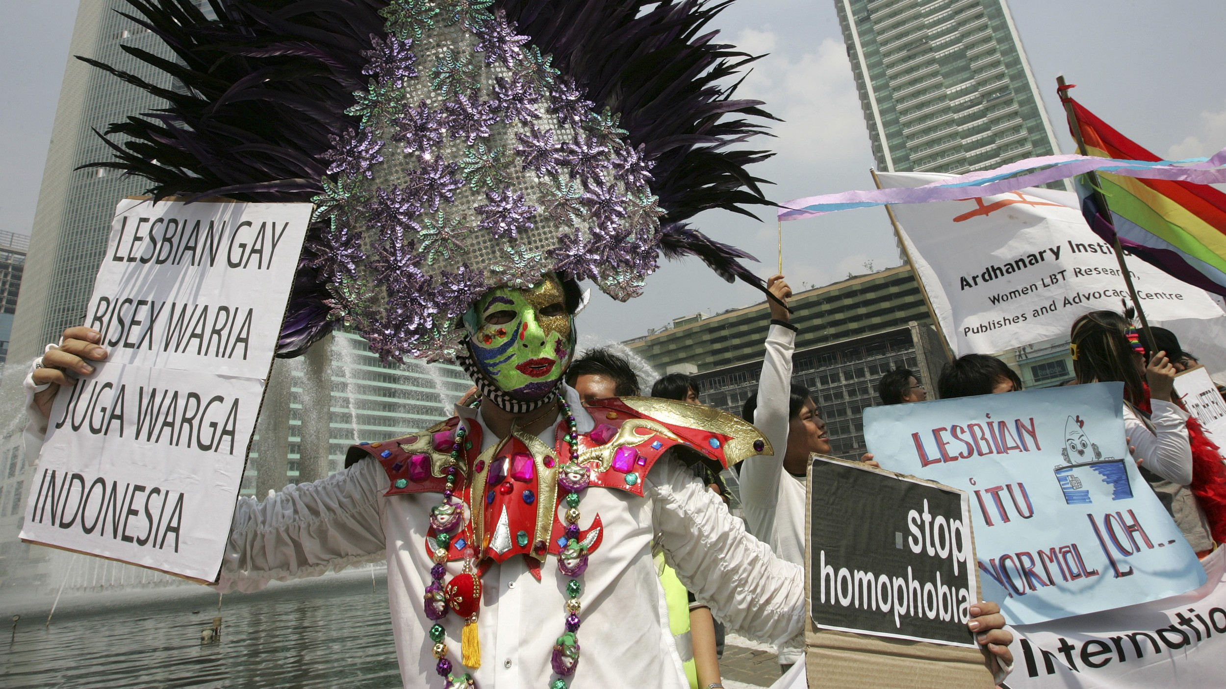 A transsexual holds a placard during an International Day Against Homophobia demonstration along Jakarta's main street