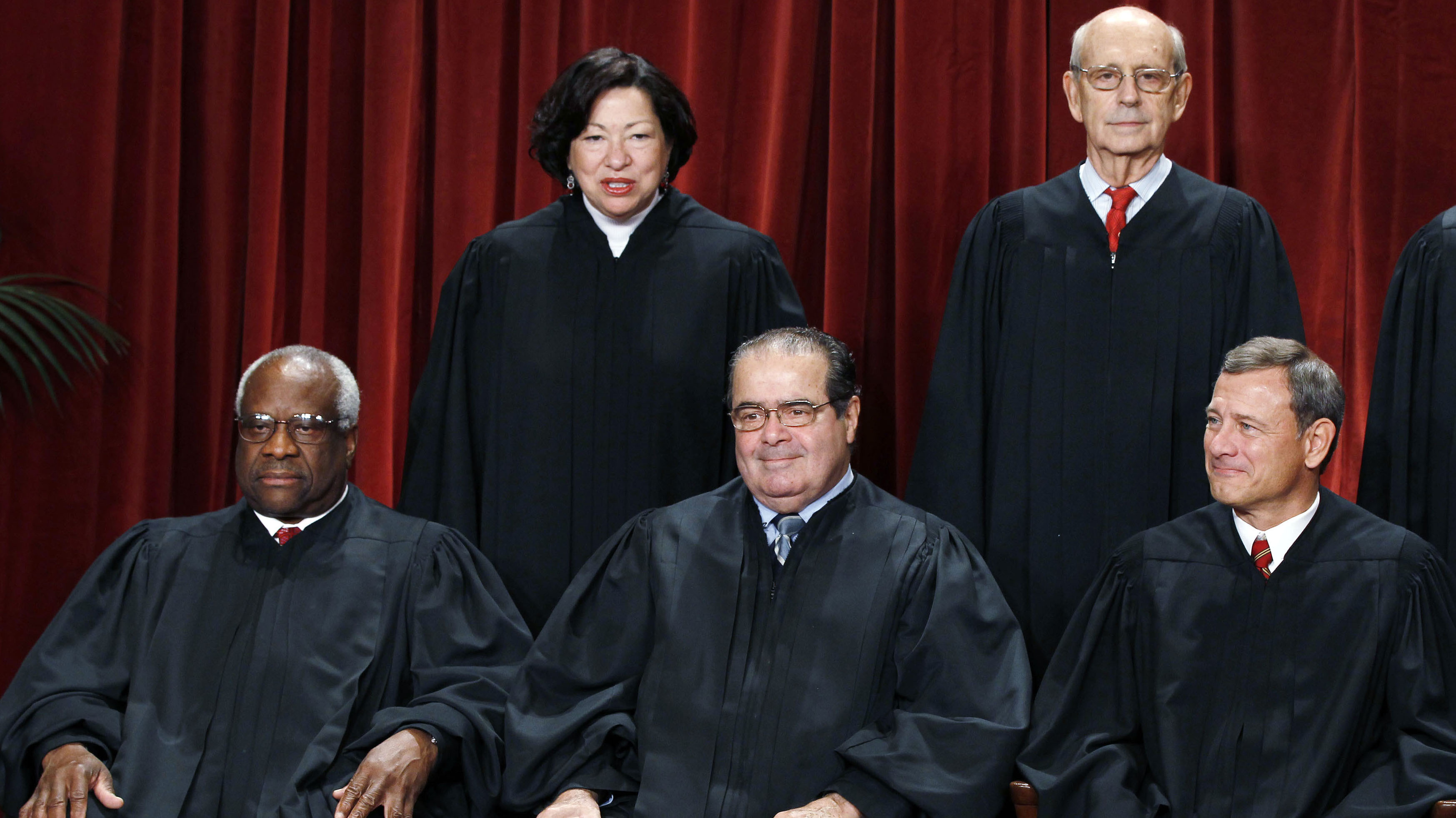 The justices of the U.S. Supreme Court gather for a group portrait in the East Conference Room at the Supreme Court Building in Washington