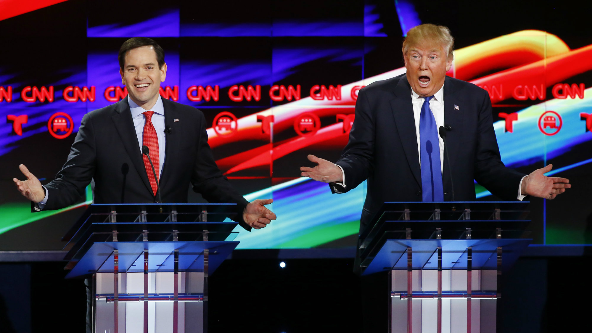 Marco Rubio and Donald Trump react to each other as they discuss an issue during the debate sponsored by CNN for the 2016 Republican U.S. presidential candidates in Houston, Texas, February 25, 2016.