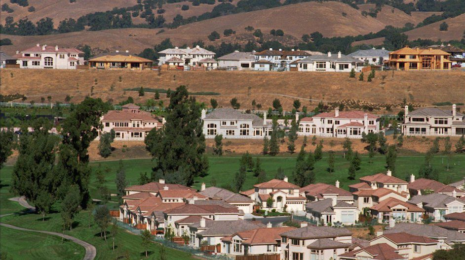 Million dollar homes are under construction on a hillside above Silver Creek Valley Country Club in San Jose, Calif., Tuesday, Oct. 15, 1996. The Silicon Valley area is seeing a boom in housing sales.  (AP Photo/Scott Anger)