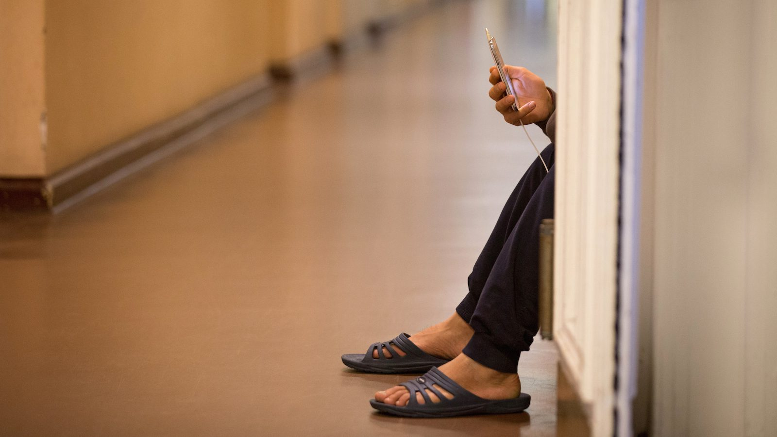 Refugee with mobile phone