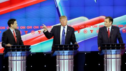 Republican presidential candidate, businessman Donald Trump, center, speaks as Republican presidential candidate, Sen. Marco Rubio, R-Fla., left, and Republican presidential candidate, Sen. Ted Cruz, R-Texas, right, look on during a Republican presidential primary debate at The University of Houston, Thursday, Feb. 25, 2016, in Houston.