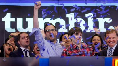 David Karp, third from right, Founder and CEO of Tumblr, reacts as confetti flies during the opening bell at Nasdaq, Thursday, July 11, 2013 in New York. Derek Gottfrid, Tumblr vice president, raises his fist. Yahoo acquired the online blogging forum for $1.1 billion in June. Tumblr will remain independently operated and Karp will stay CEO. (AP Photo/Mark Lennihan)