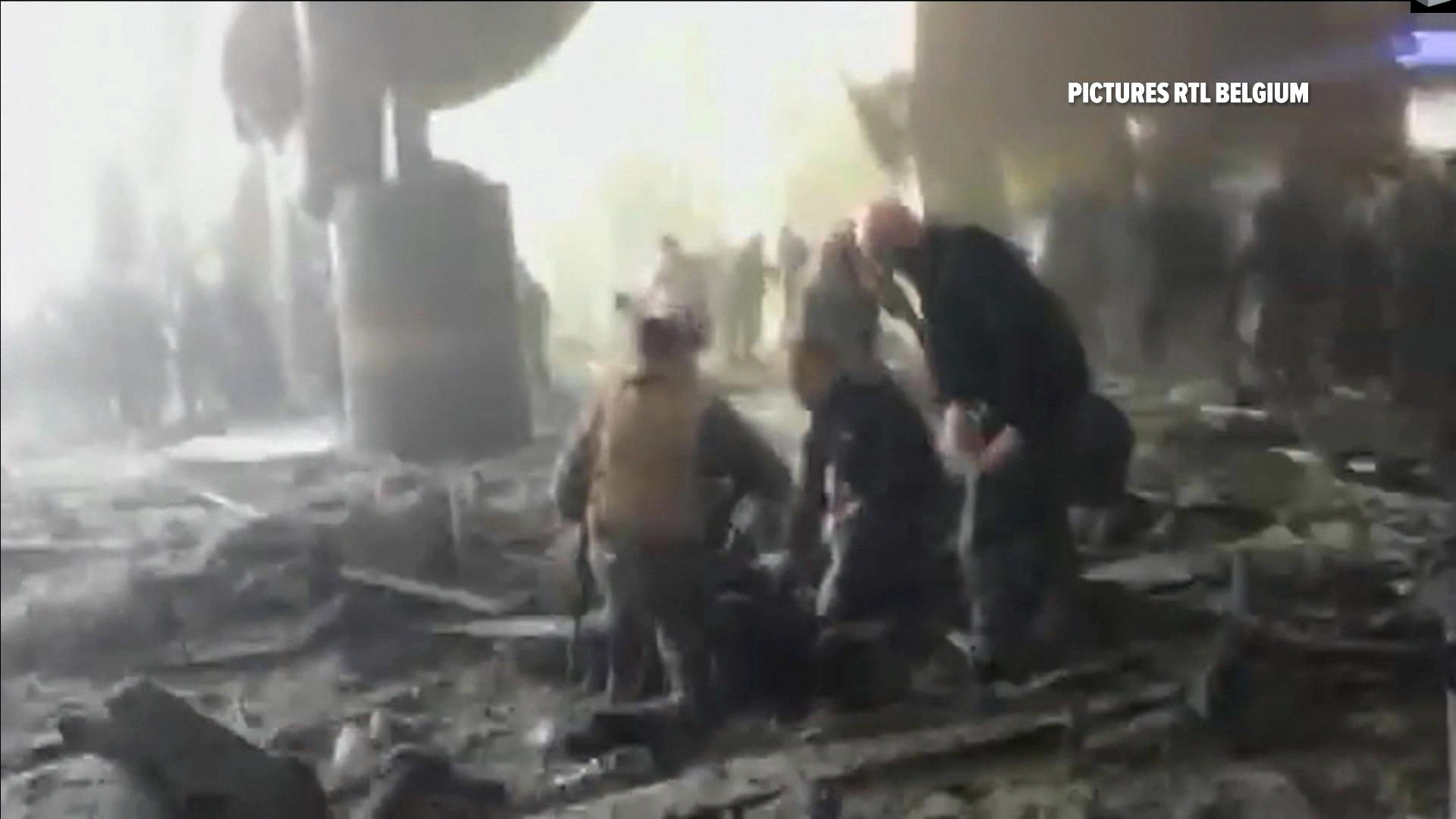 Still from a television image showing the aftermath of the airport bombing.