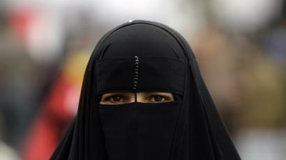 An Egyptian woman wears a niqab at Tahrir Square in Cairo.