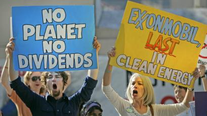 Protesters shout outside a 2006 ExxonMobil shareholders meeting.