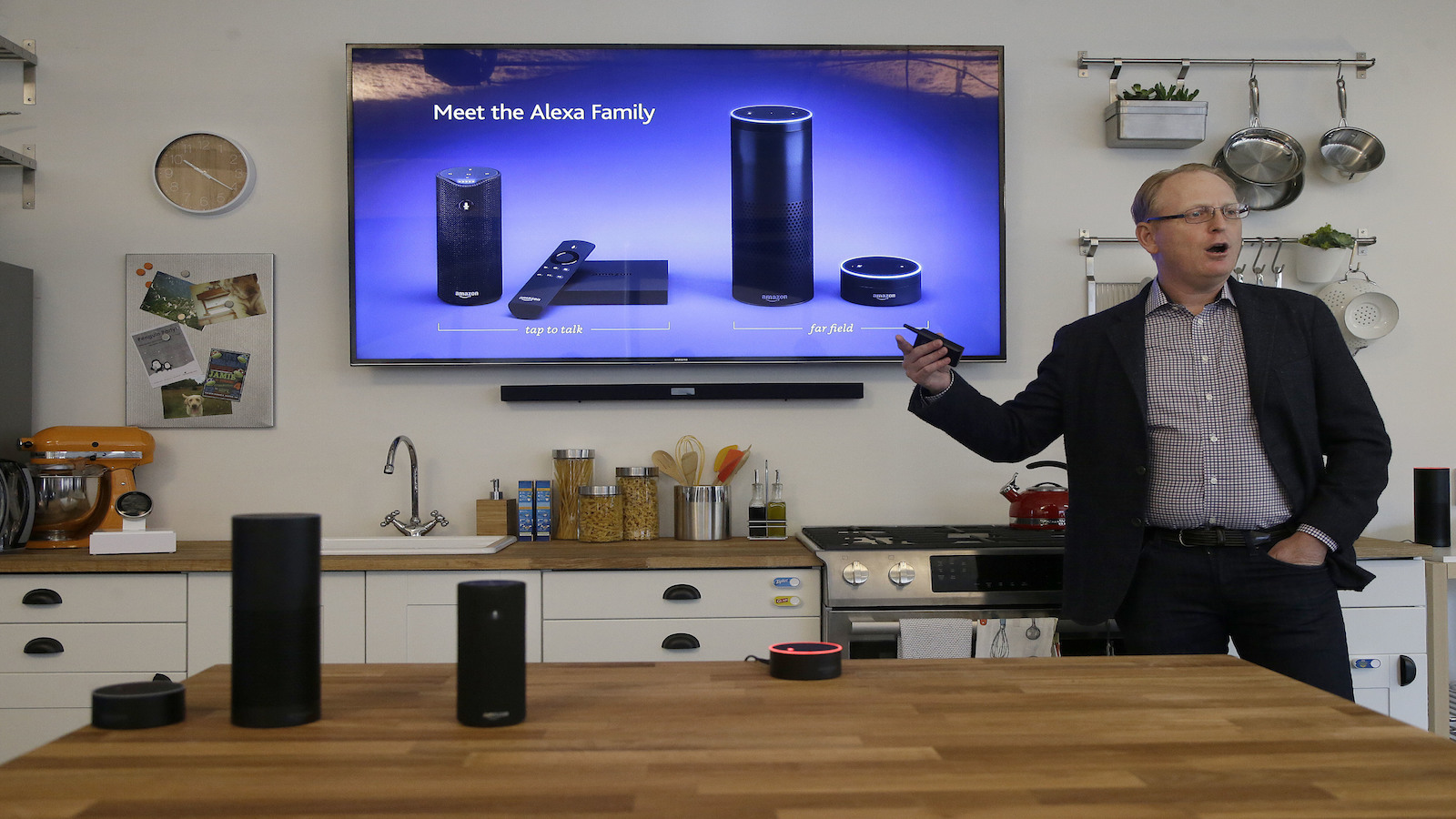 In this Wednesday, March 2, 2016 photo, David Limp, Amazon Senior Vice President of Devices, speaks about Alexa family devices in San Francisco. Amazon.com is introducing two devices, the Amazon Tap and Echo Dot, that are designed to amplify the role that its voice-controlled assistant Alexa plays in people's homes and lives.
