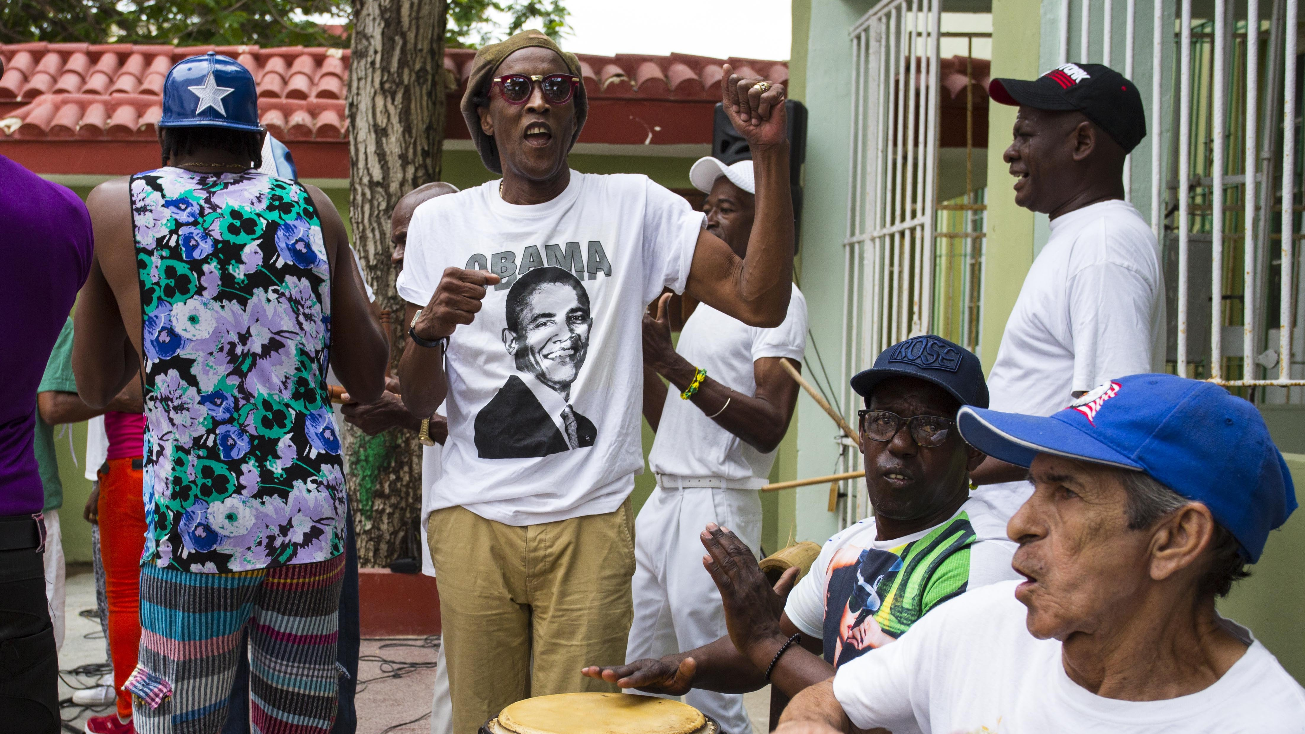 A musician performs wearing a T-shirt designed with an image of President Barack Obama at a weekly rumba dance gathering in Havana, Cuba, Saturday, March 19, 2016. For hundreds of thousands of black Cubans, Obama isn't just the first U.S. leader to visit their country in nearly nine decades. He's a black man whose rise to the world's most powerful job is a source of pride and inspiration for a community that still struggles with informal racism and economic disadvantage despite the revolutionary government's attempt to end racial prejudice in Cuba. ()