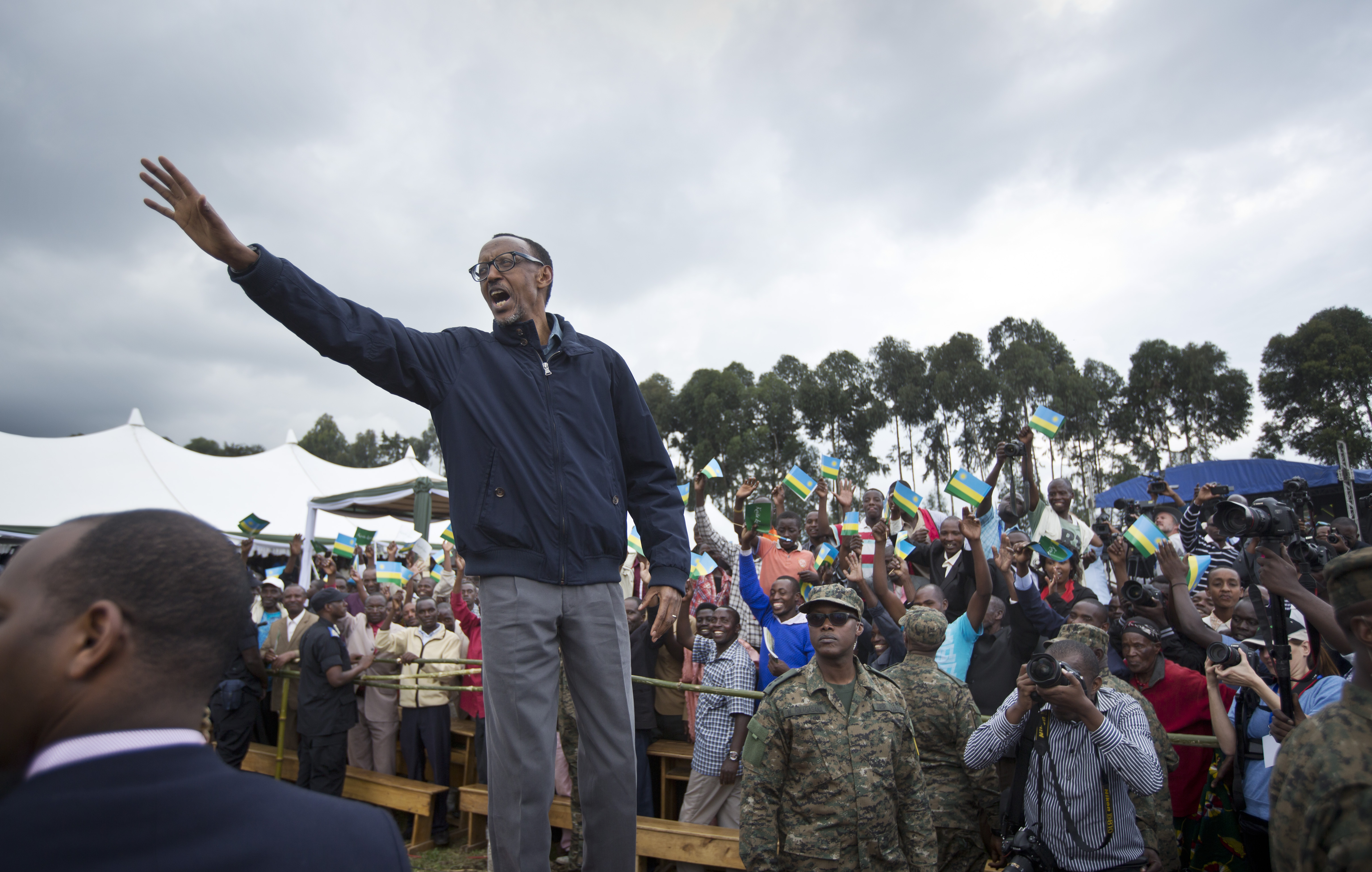 FILE - In this Saturday, Sept. 5, 2015 file photo, Rwanda's President Paul Kagame waves to the crowd before speaking at a baby gorilla naming ceremony in Kinigi, northern Rwanda. Rwanda will vote on Dec. 18, 2015 in a referendum which would allow President Paul Kagame to run again for re-election when his current seven-year term ends in 2017, as he is currently ineligible because the Rwandan constitution limits a president to two terms. (AP Photo/Ben Curtis, File)