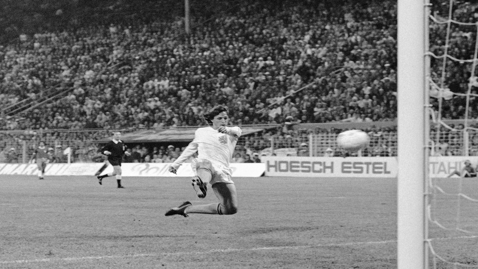 FILE - In this July 3, 1974 file photo, Dutch forward Johann Cruyff scores his team?s second goal against Brazil in their World Cup Soccer match, in Dortmund, West Germany. On this day: The Netherlands beats Brazil 2-0 to qualify for the World Cup final.