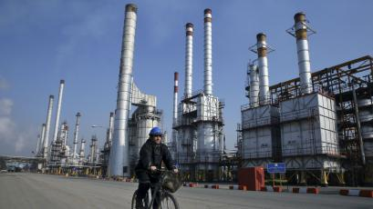 An Iranian oil worker rides his bicycle at the Tehran oil refinery, south of the capital Tehran, Iran.