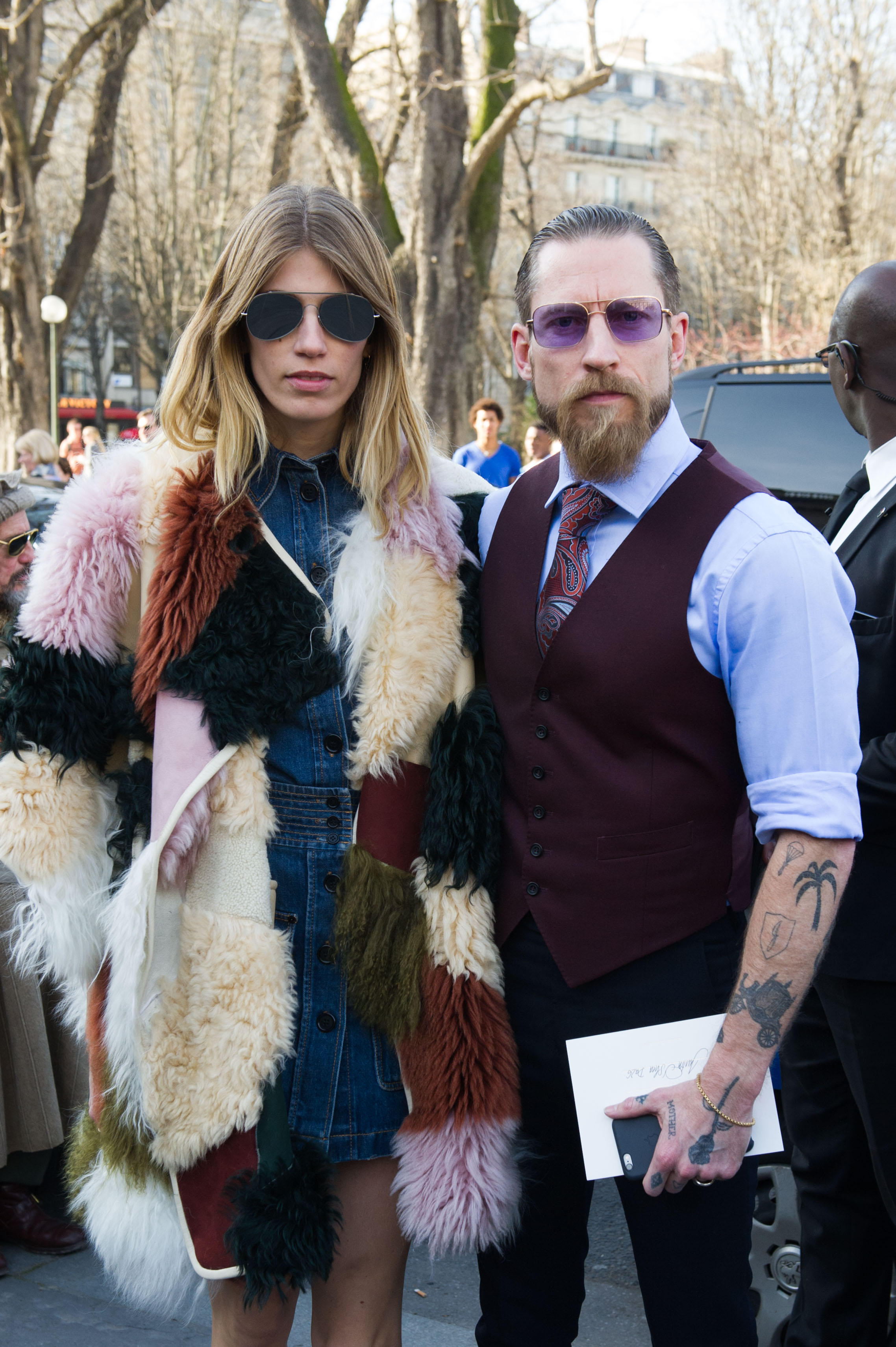 Buying director Justin Daniel O'Shea, right, and fashion editor Veronika Heilbrunner pose as they arrive for Chloe's ready to wear fall-winter 2015-2016 fashion collection during Paris fashion week, Paris, France, Sunday, March 8, 2015.