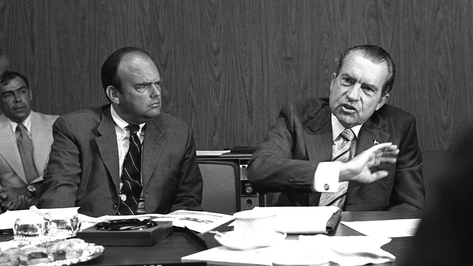 President Nixon, right, discusses improving conditions at a California state park as John D. Ehrlichman, Nixon's domestic affairs adviser, listens in this 1972 photo. Ehrlichman, who was imprisoned for 18 months for his part in the Watergate conspiracy, died Sunday of natural causes at the age of 73.()