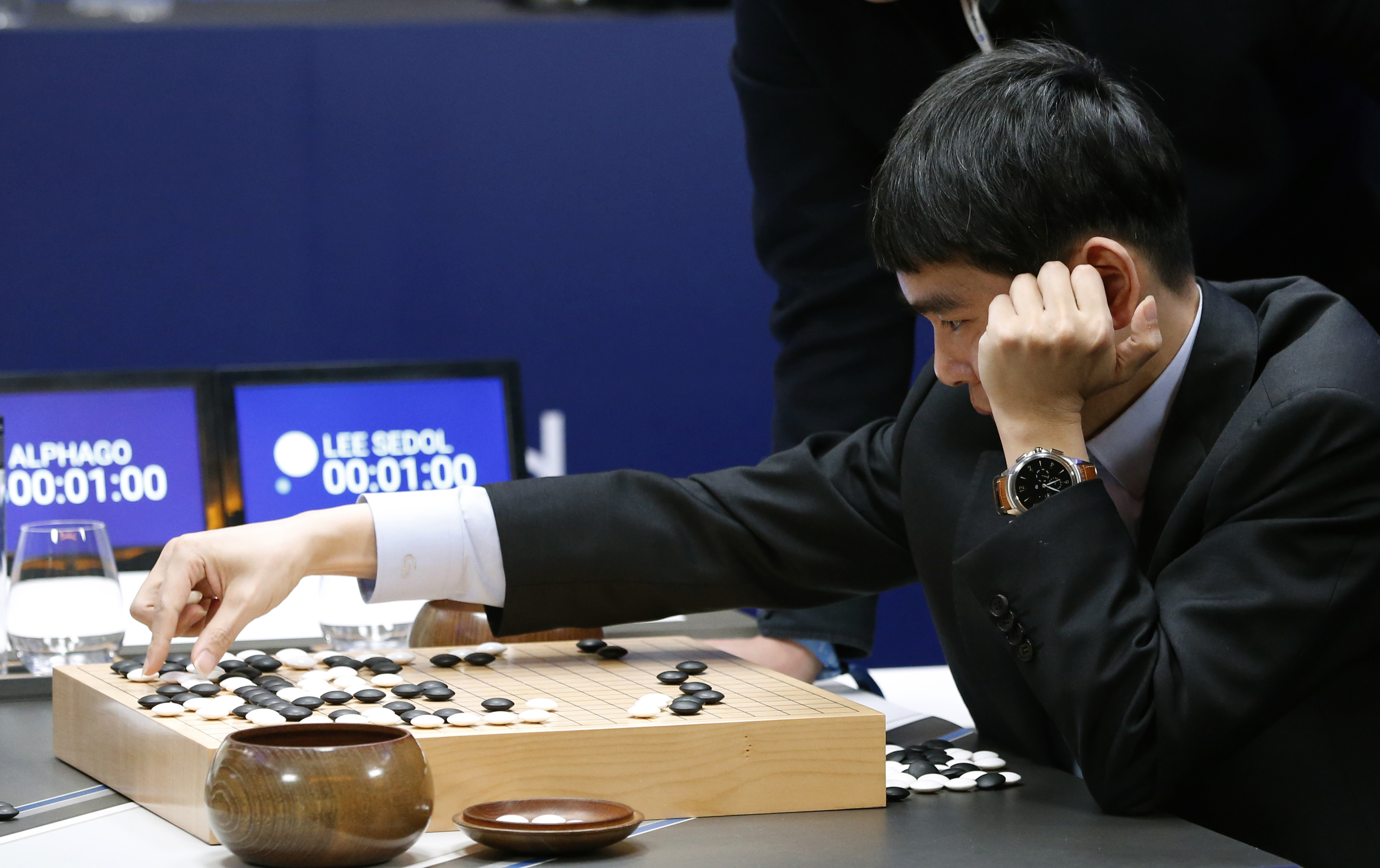 """South Korean professional Go player Lee Sedol reviews the match himself after finishing the second match of the Google DeepMind Challenge Match against Google's artificial intelligence program, AlphaGo in Seoul, South Korea, Thursday, March 10, 2016. The human Go champion said he was left """"speechless"""" after his second straight loss to Google's Go-playing machine on Thursday in a highly-anticipated human versus machine face-off. (AP Photo/Lee Jin-man)"""