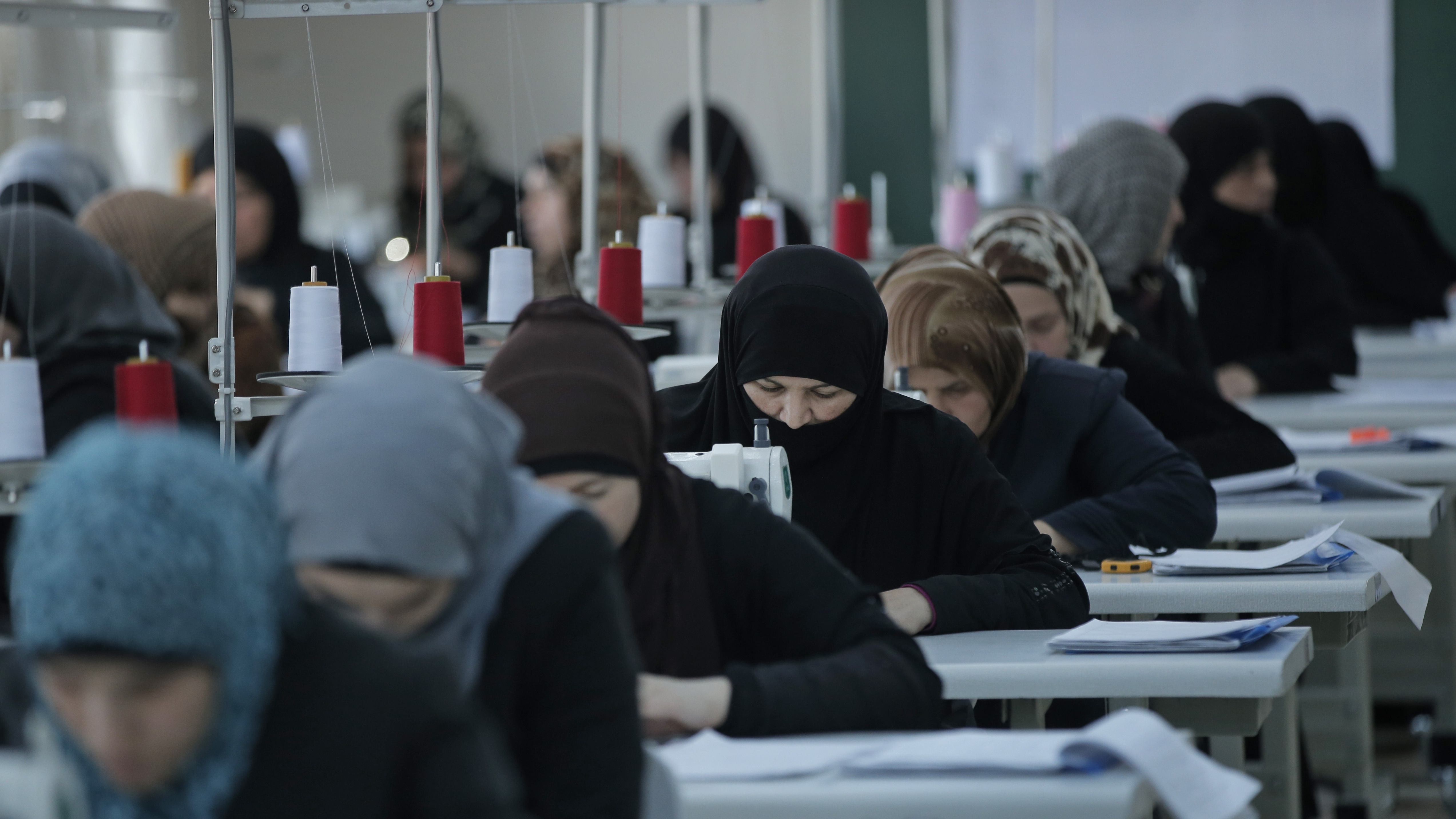 Syrian refugee women train during a sewing workshop at the Oncupinar refugee camp for Syrian refugees next to the border crossing with Syria, near the town of Kilis in southeastern Turkey, Thursday, March 17, 2016.