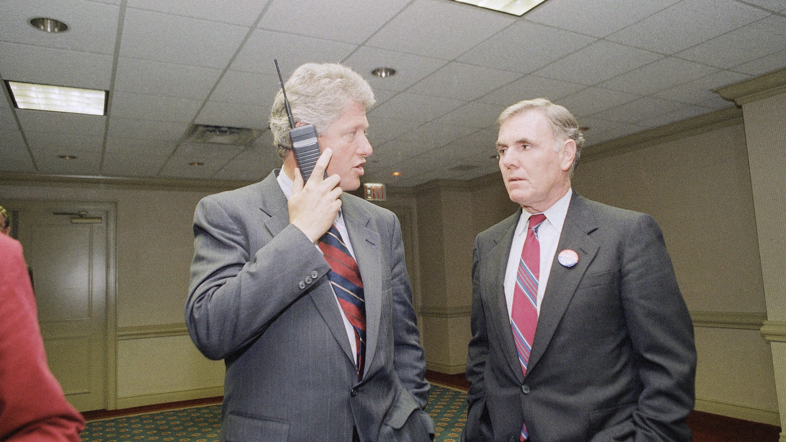Democratic presidential nominee Bill Clinton talks on a cellular phone while meeting with Boston Mayor Ray Flynn in a New York hotel Thursday, Sept. 25, 1992. Clinton met with the Democratic National Committee at the hotel and is scheduled to campaign in Massachusetts on Friday. ()
