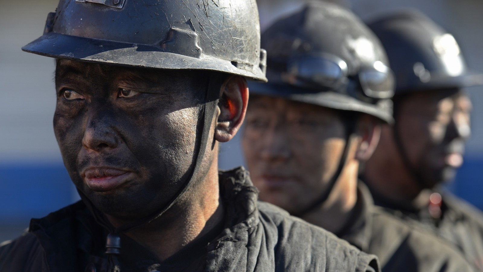 Miners wait in lines to shower during a break near a coal mine in Heshun county, Shanxi province