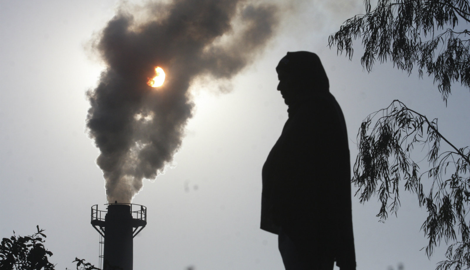 A smoke rises from a chimney of a garbage processing plant on the outskirts of the northern Indian city of Chandigarh December 8, 2010. Many rich countries, suffering weak growth and budget cuts, want emerging economies led by fast-growing China and India to do far more to reflect their growing power, including greater oversight of their curbs on greenhouse gas emissions.