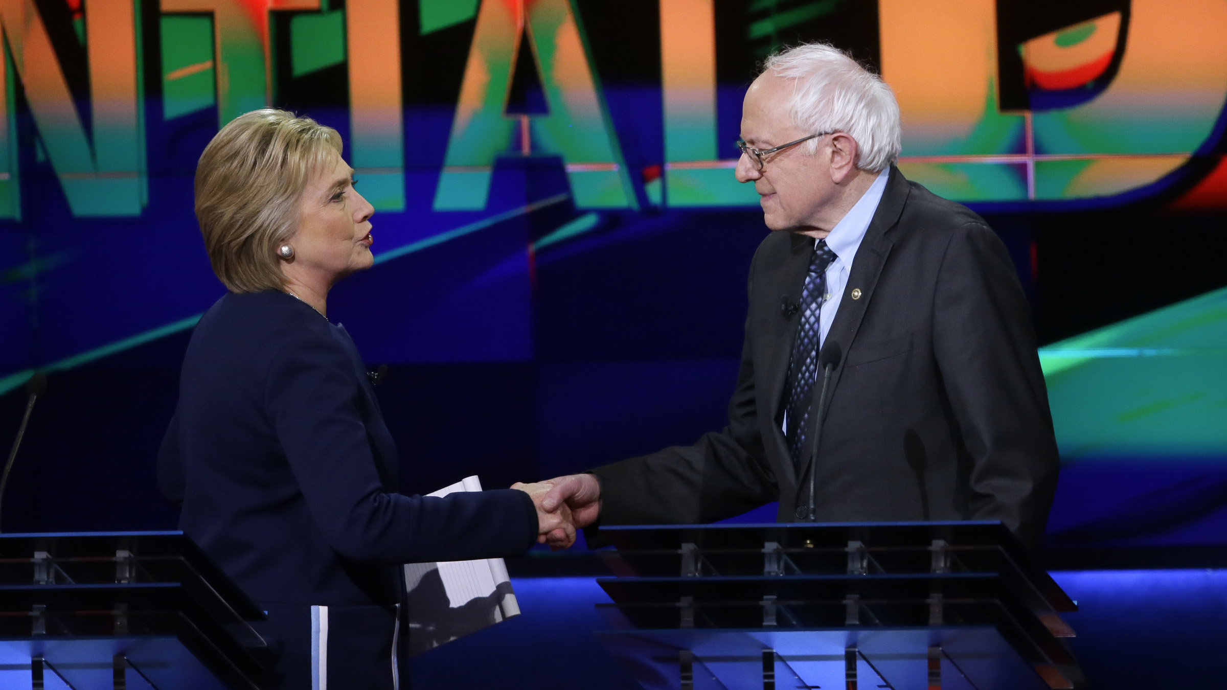 Democratic presidential candidates, Hillary Clinton and Sen. Bernie Sanders, I-Vt., right, shake hands at the end of a Democratic presidential primary debate at the University of Michigan-Flint, Sunday, March 6, 2016, in Flint, Mich.
